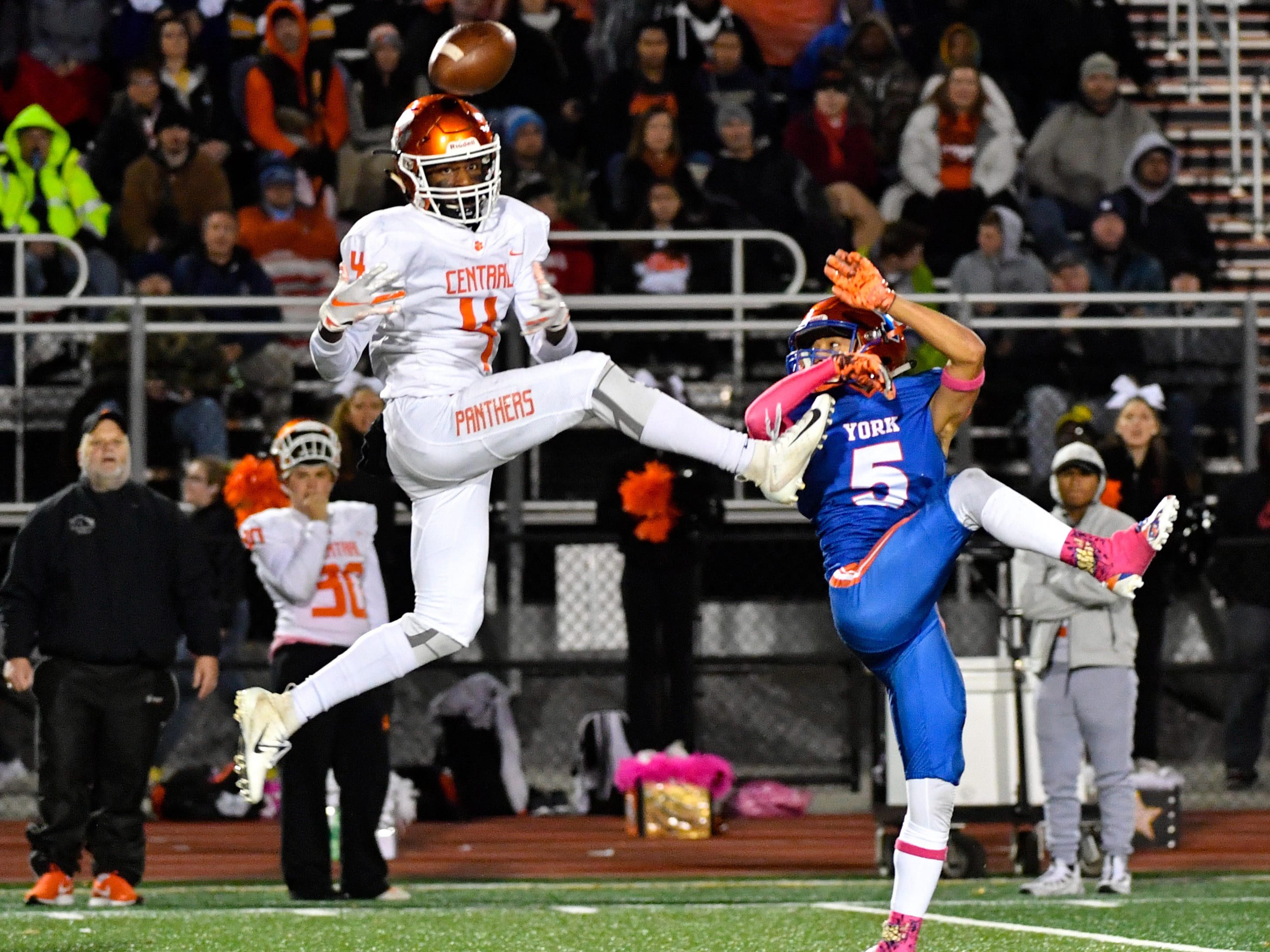 Saahir Cornelius (4) of Central York rises up to receive the ball during the YAIAA Division I title game at Smalls Athletic Field, Friday, October 26, 2018. The York High Bearcats defeated the Central York Panthers 54-14.