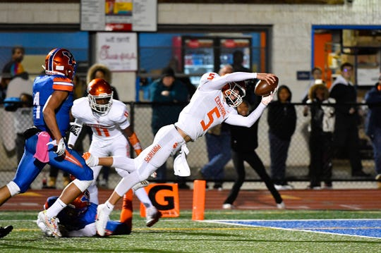 Beau Pribula (5) dives in for the touchdown during the YAIAA Division I title game at Smalls Athletic Field, Friday, October 26, 2018. The York High Bearcats defeated the Central York Panthers 54-14.