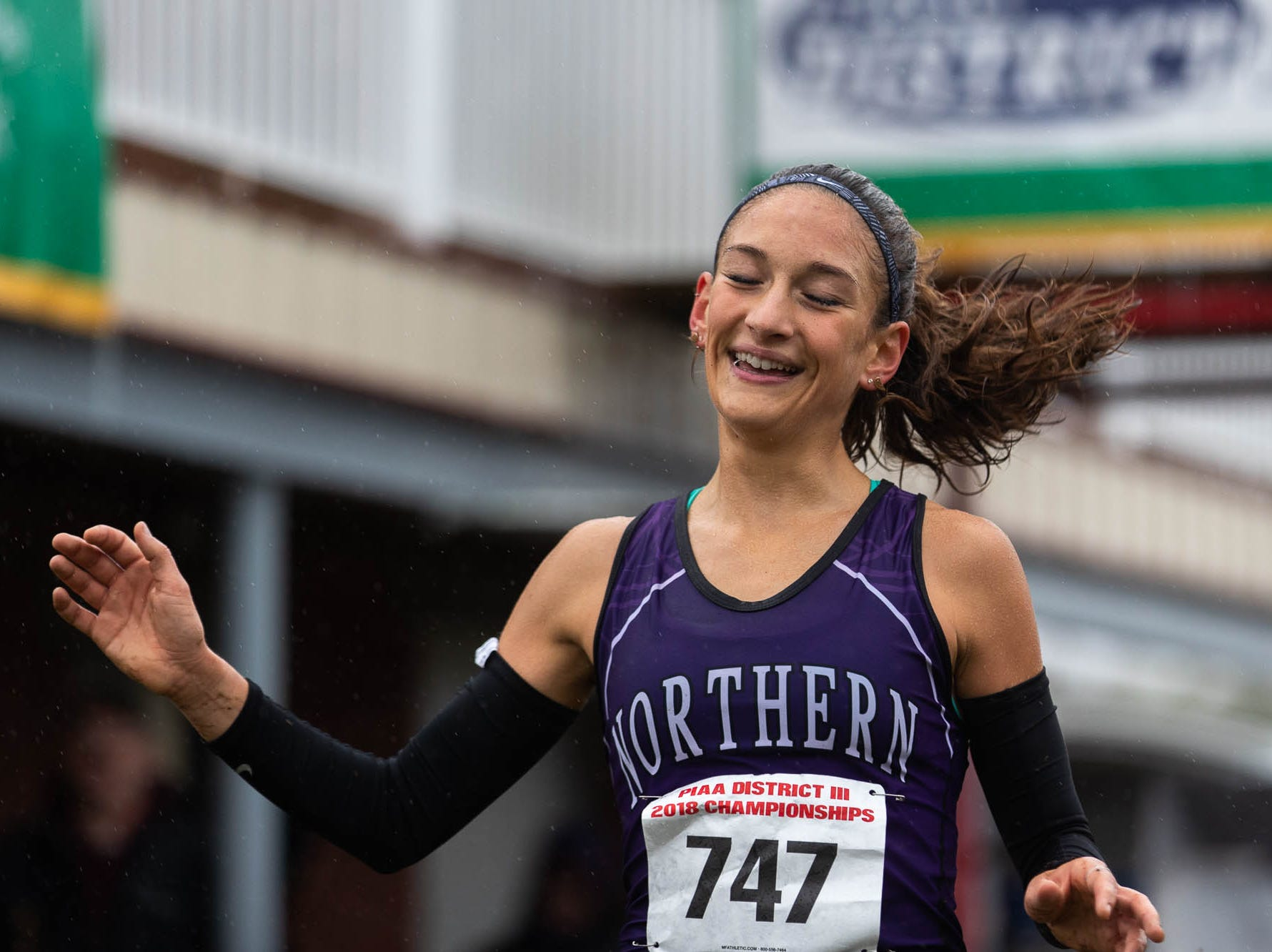Northern's Marlee Starliper (747) smiles as she finishes first in the Girls AA race during the PIAA District III Cross Country Championship, Saturday, Oct. 27, 2018, at Big Spring High School in Newville.