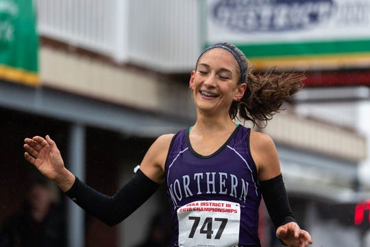 Northern's Marlee Starliper smiles as she finishes first in the Girls AA race during the PIAA District III Cross Country Championship last October.