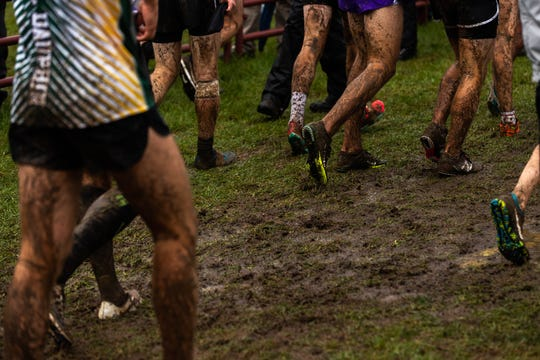 Mud covers runners as they finish the Boys AAA race during the PIAA District III Cross Country Championship, Saturday, Oct. 27, 2018, at Big Spring High School in Newville.