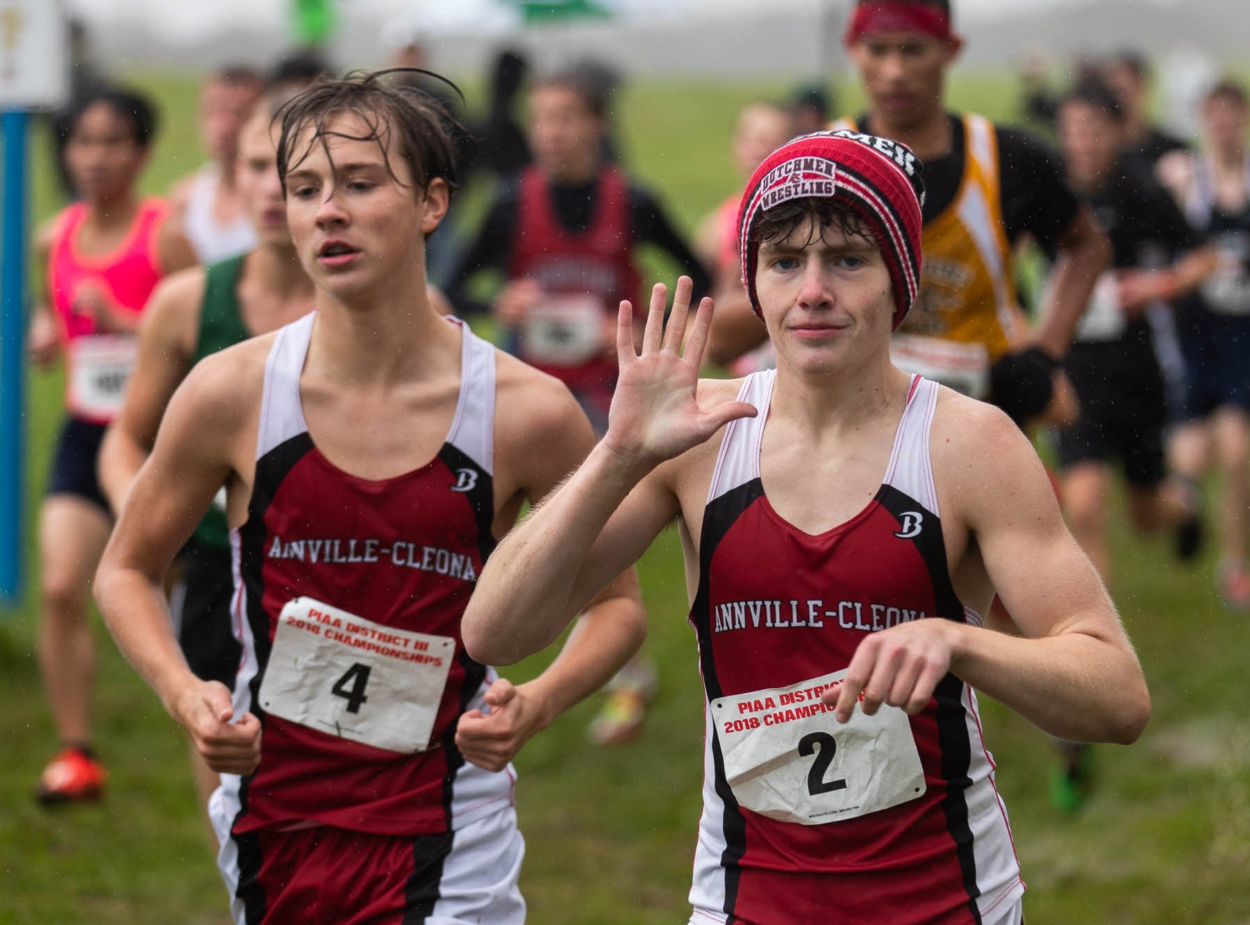 Annville-Cleona's Matthew Inman waves while racing in the Boys AA race during the PIAA District III Cross Country Championship, Saturday, Oct. 27, 2018, at Big Spring High School in Newville.