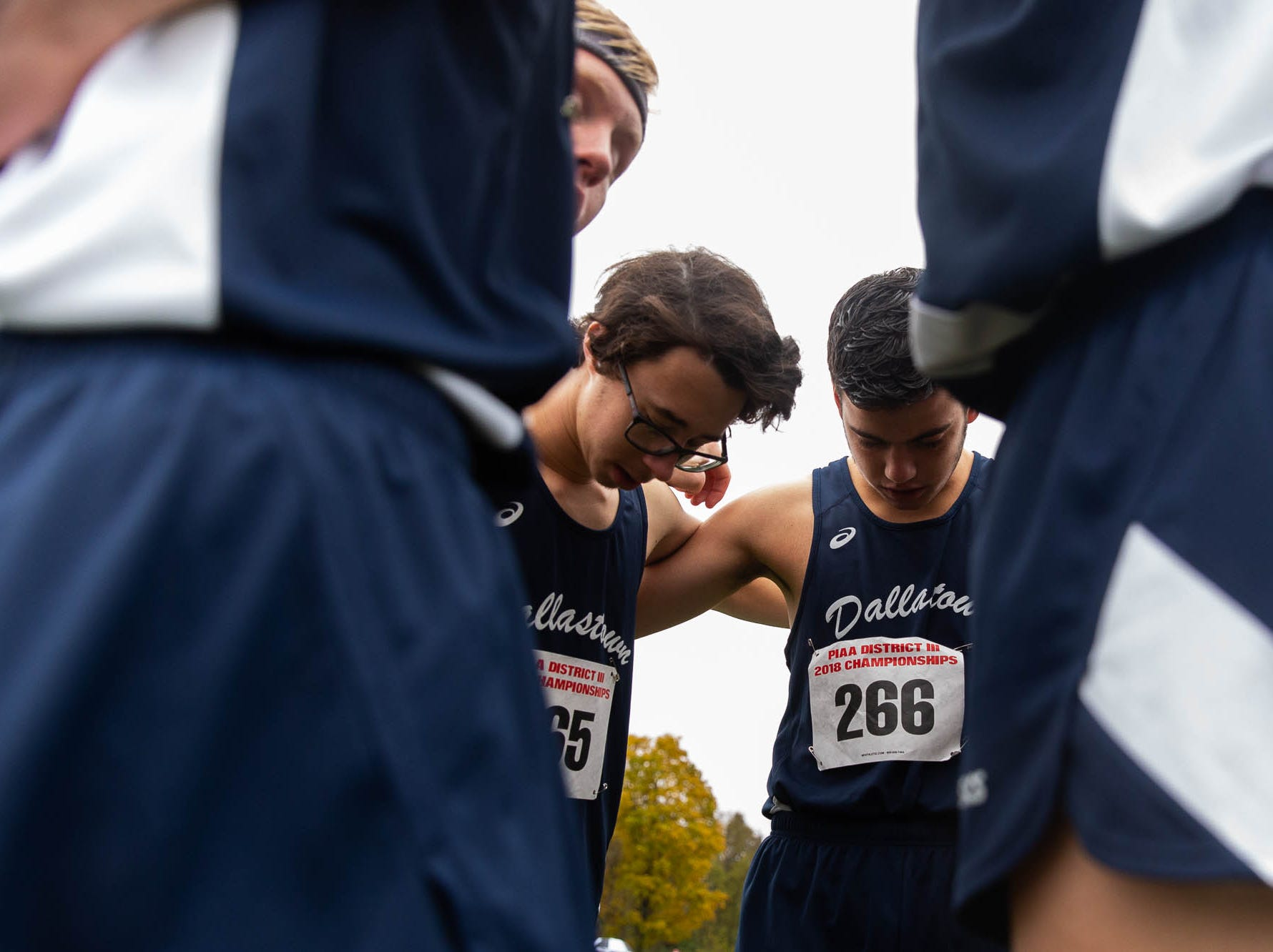 The Dallastown boys team takes a moment before the Boys AAA race during the PIAA District III Cross Country Championship, Saturday, Oct. 27, 2018, at Big Spring High School in Newville.
