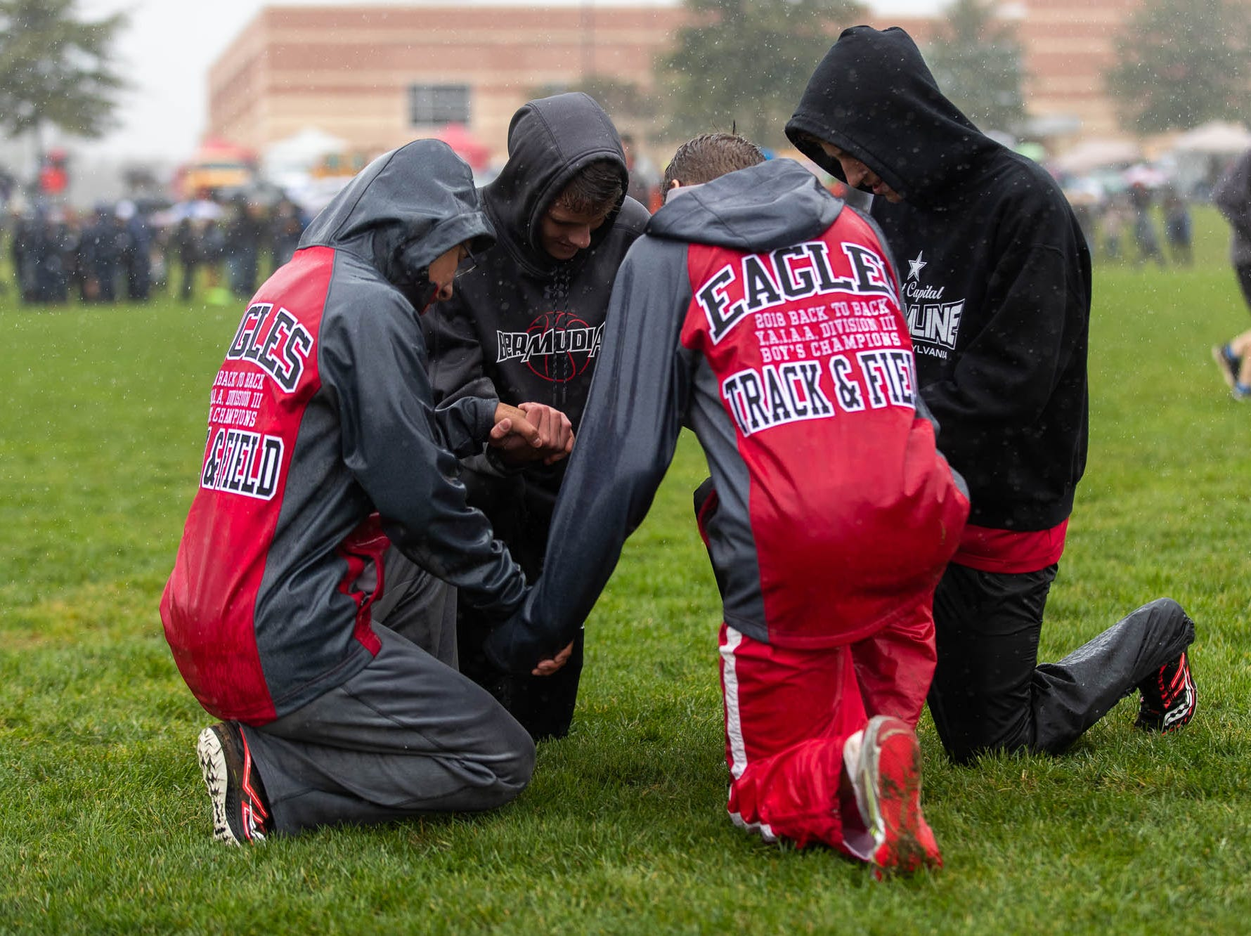 The Bermudian Springs Eagles take a moment before their race during the PIAA District III Cross Country Championship, Saturday, Oct. 27, 2018, at Big Spring High School in Newville.
