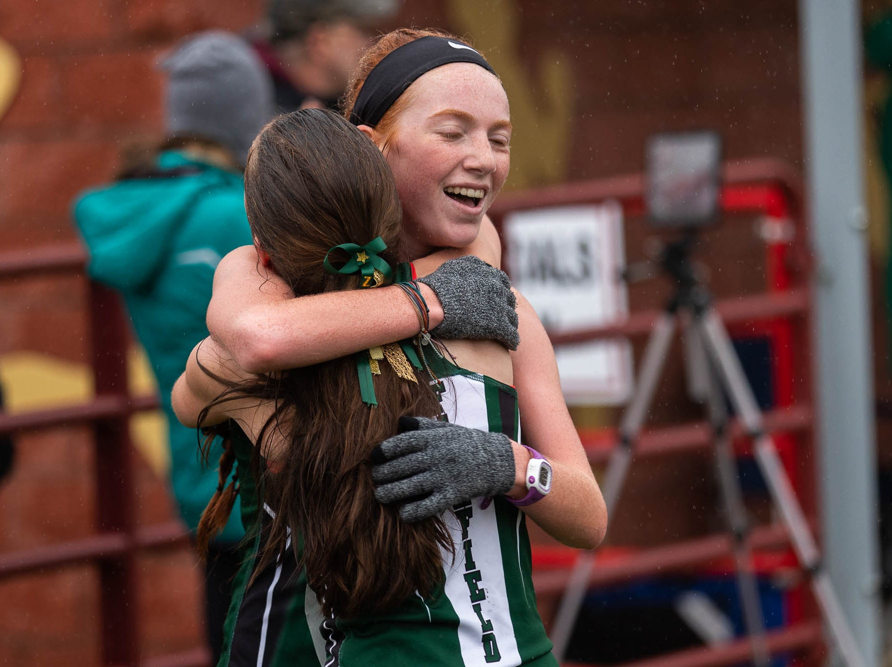 Fairfield's Zoey Kline and Haley Hebenton embrace after finishing 34rd and 35th in the Girls A race during the PIAA District III Cross Country Championship, Saturday, Oct. 27, 2018, at Big Spring High School in Newville.