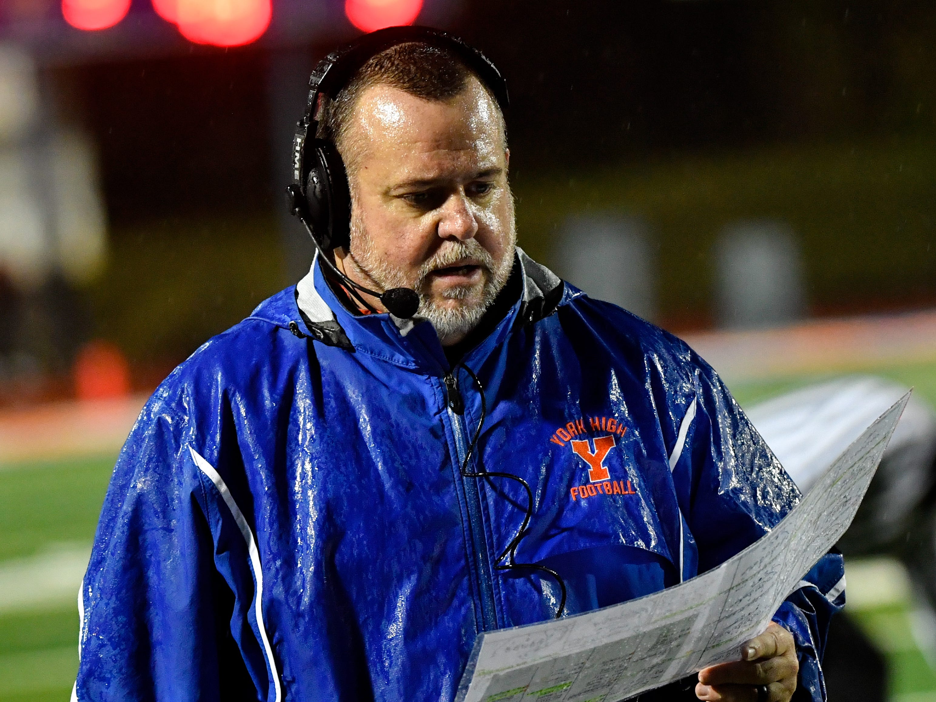 York High coach Russ Stoner decides what play to call next during the YAIAA Division I title game at Smalls Athletic Field, Friday, October 26, 2018. The York High Bearcats defeated the Central York Panthers 54-14.