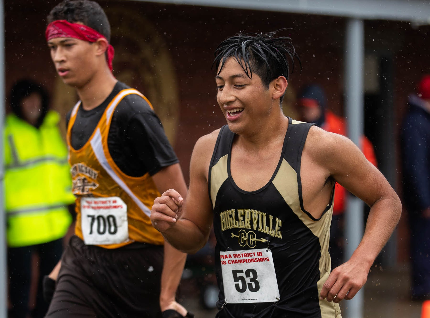 Biglerville's Isaac Sierra-Sota (53) smiles as he crosses the finishline during the PIAA District III Cross Country Championship, Saturday, Oct. 27, 2018, at Big Spring High School in Newville.