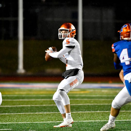 Beau Pribula (5) drops back to throw during the YAIAA Division I title game at Smalls Athletic Field, Friday, October 26, 2018. The York High Bearcats defeated the Central York Panthers 54-14.