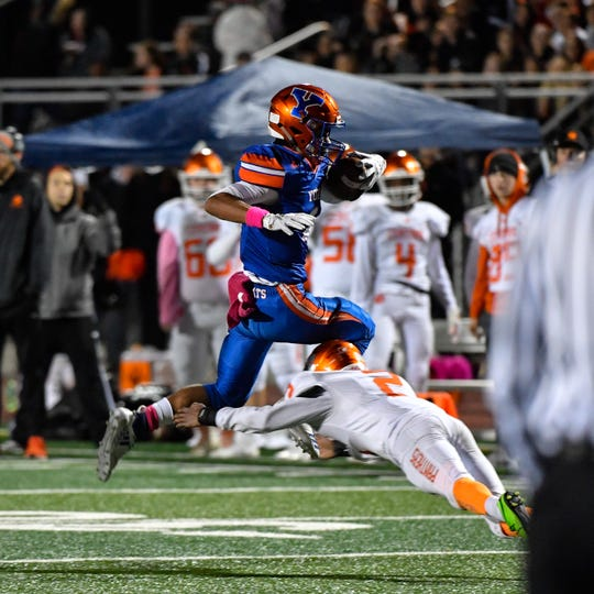 Tobee Stokes vaults over the tackle during the YAIAA Division I title game at Smalls Athletic Field, Friday, October 26, 2018. The York High Bearcats defeated the Central York Panthers 54-14.