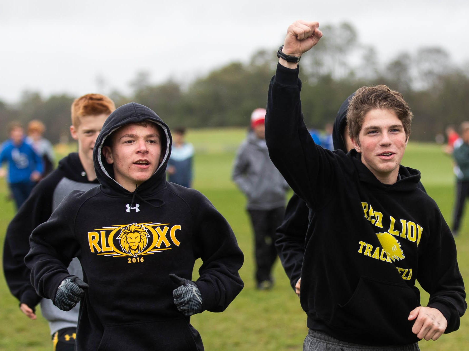 The Red Lion boys team warms up for the Boys AAA race during the PIAA District III Cross Country Championship, Saturday, Oct. 27, 2018, at Big Spring High School in Newville.
