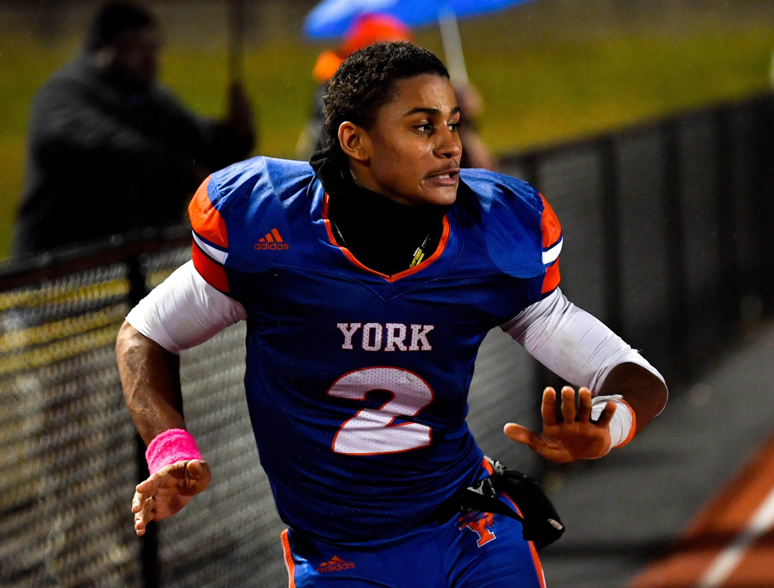 Tobee Stokes dances after York High's win over Central York, Friday, October 26, 2018. The Bearcats defeated the Panthers 54-14.