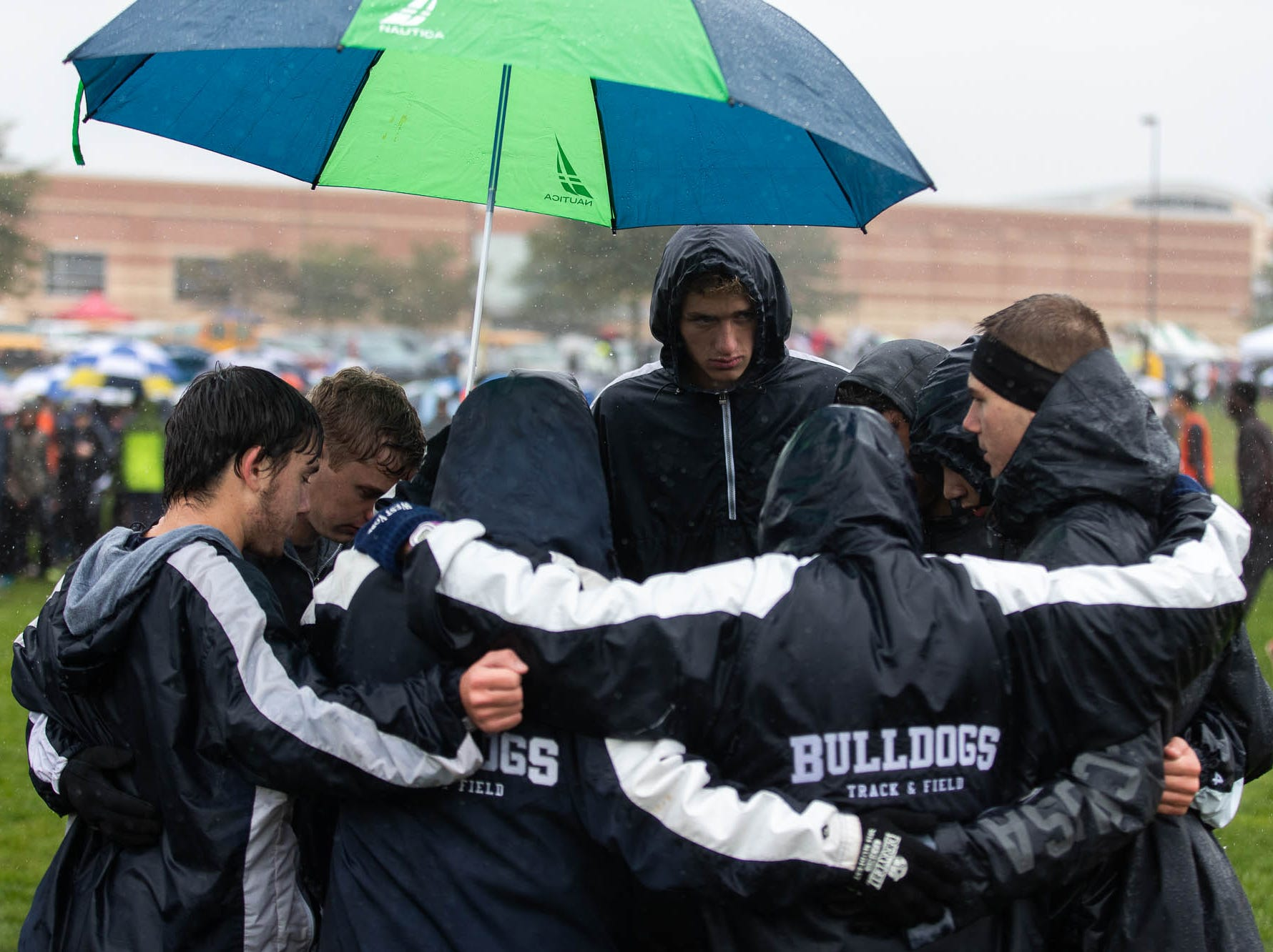 Members of the West York Boys AA team take a moment before their race during the PIAA District III Cross Country Championship, Saturday, Oct. 27, 2018, at Big Spring High School in Newville.