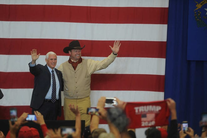 Vice President Mike Pence, Dean Heller and Adam Laxalt speak at the Carson City Airport on Oct. 27, 2018.