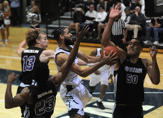 Nevada's Caleb Martin (10) drives against San Francisco State at the Virginia Street Gym on Friday.