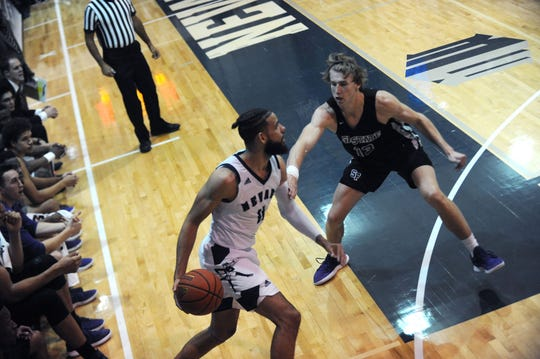 Nevada's Cody Martin (11) looks to pass against San Francisco State on Friday night.