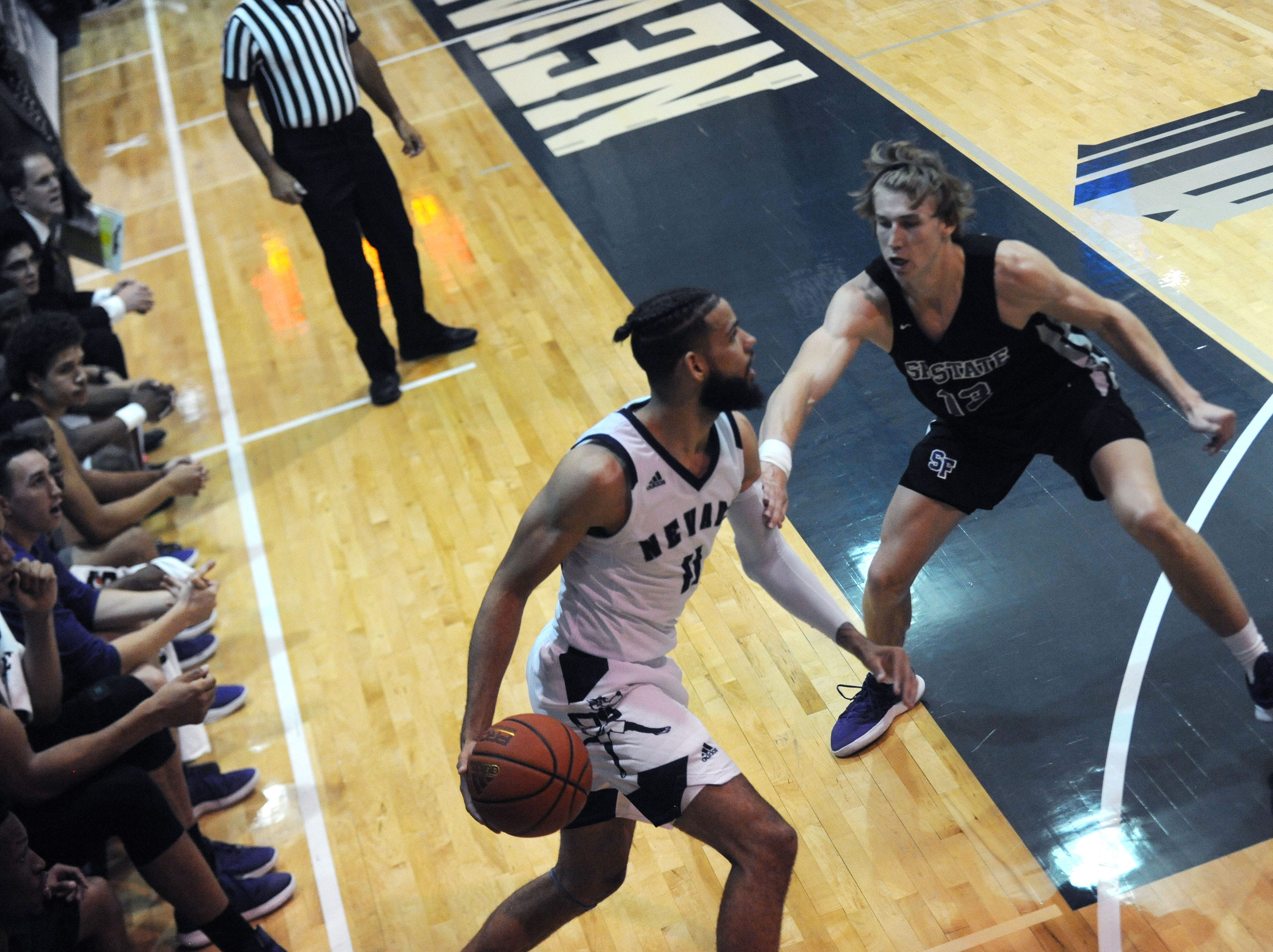 Nevada's Cody Martin (11) looks to pass while taking on San Francisco State at the Old Virginia St. Gym in Reno on Oct. 26, 2018.