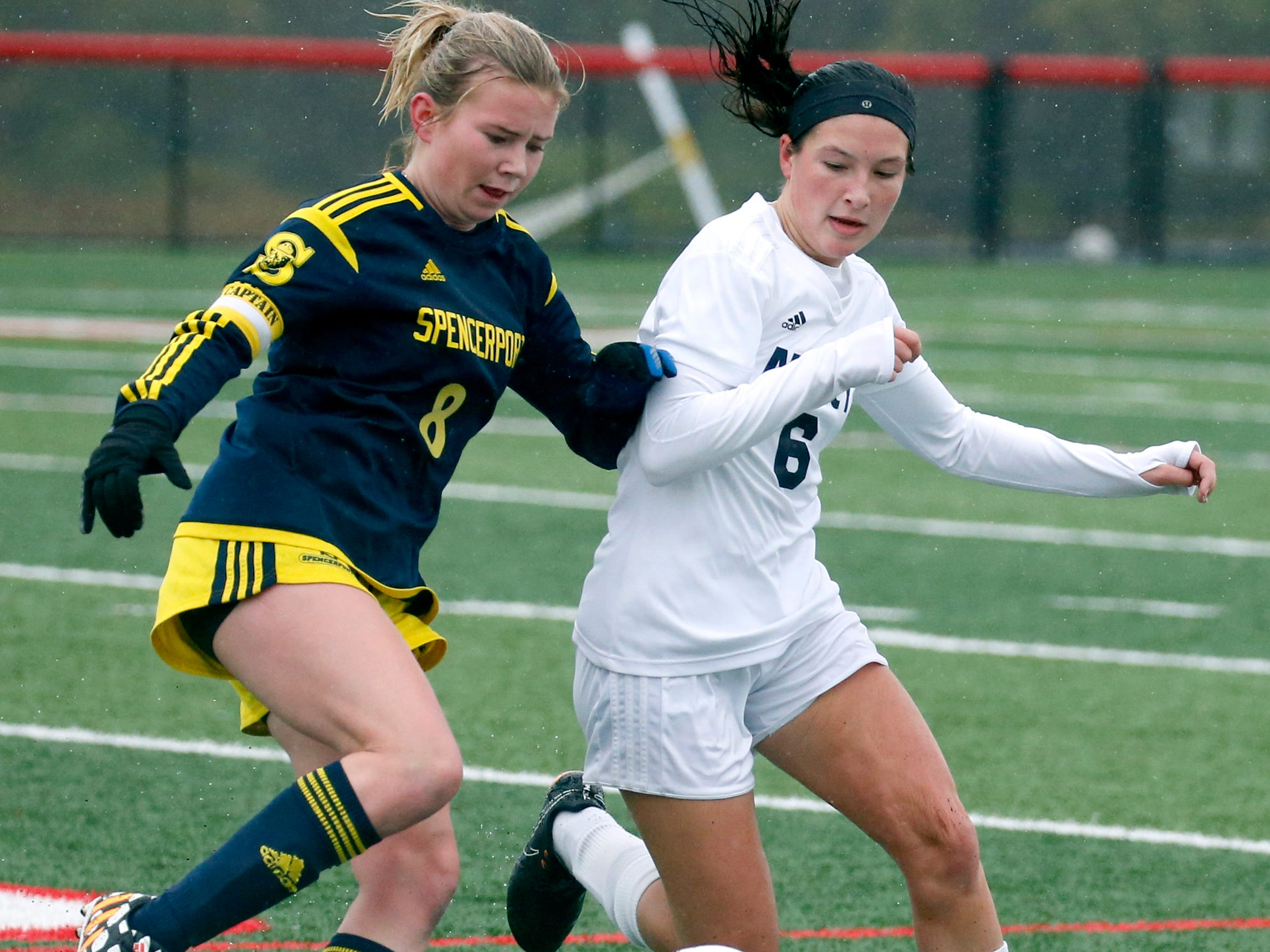 Spencerport's Leah Wengender and Mercy's Kari Schoen pursue the ball in the first half at Canandaigua Academy.