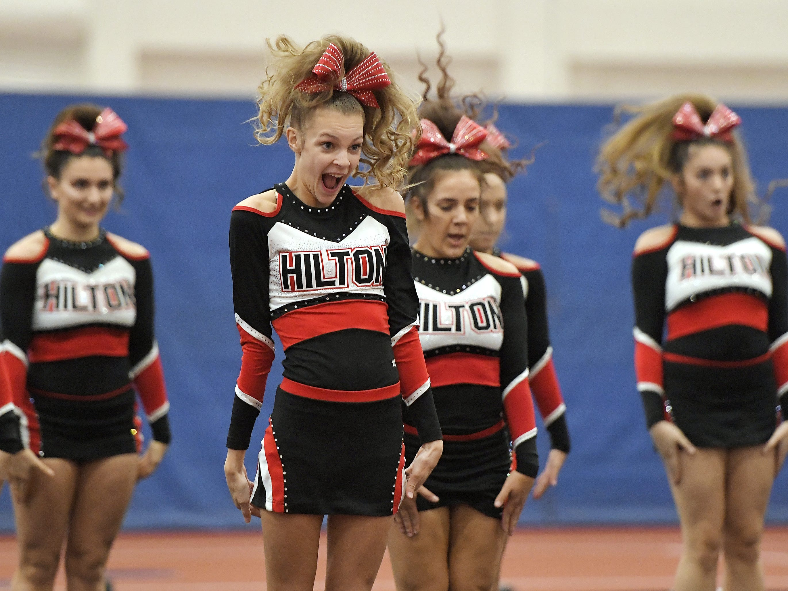 Hilton cheerleaders perform their routine during the Section V Fall Cheerleading Championships at RIT, Saturday, Oct. 27, 2018.