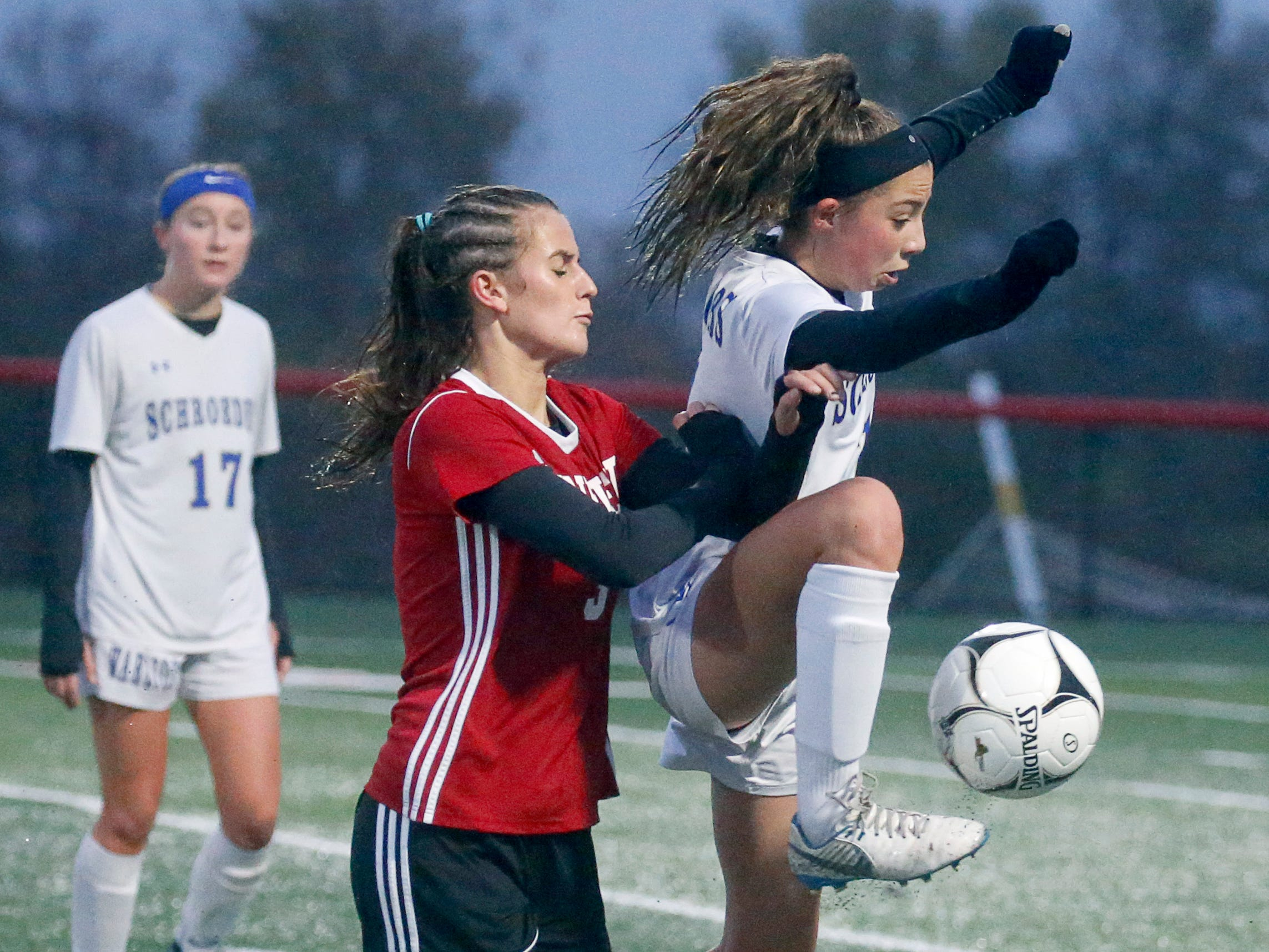 Penfield's Grace Murphy pressures Webster Schroeder's Ashley Jacobs in the first half at Canandaigua Academy.