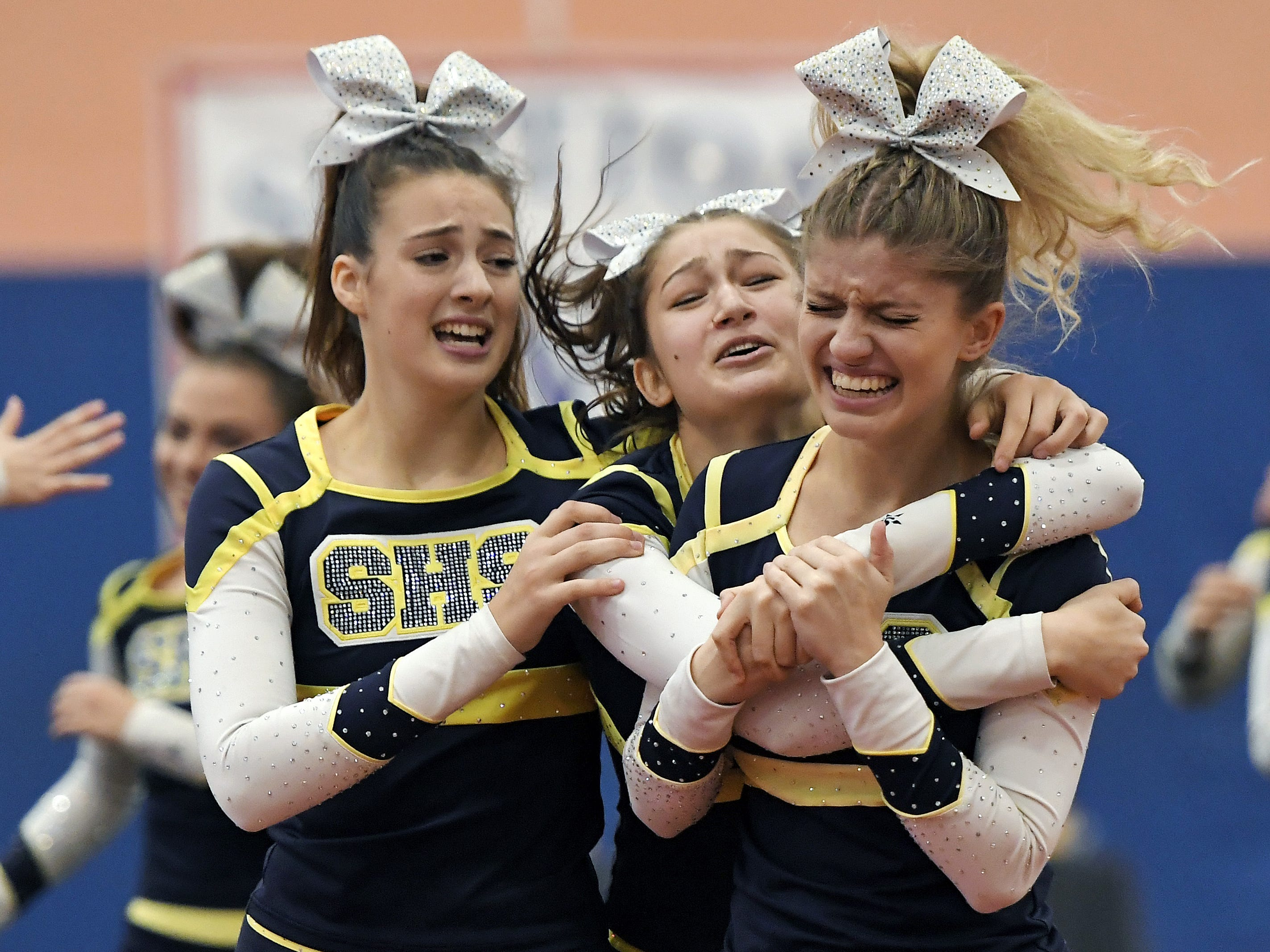 Spencerport cheerleaders celebrate after their routine during the Section V Fall Cheerleading Championships at RIT, Saturday, Oct. 27, 2018.