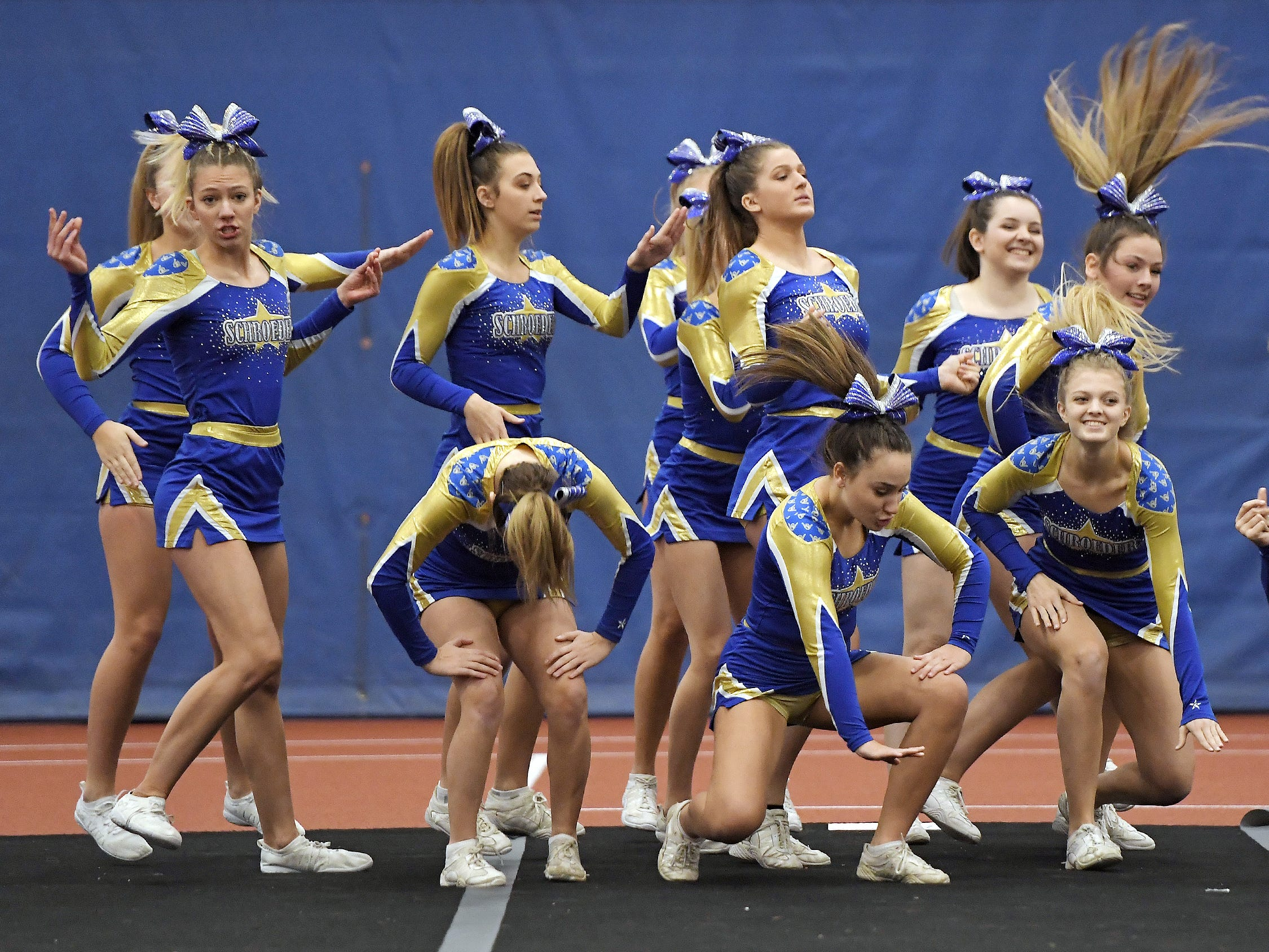 Webster Schroeder cheerleaders perform their routine during the Section V Fall Cheerleading Championships at RIT, Saturday, Oct. 27, 2018.