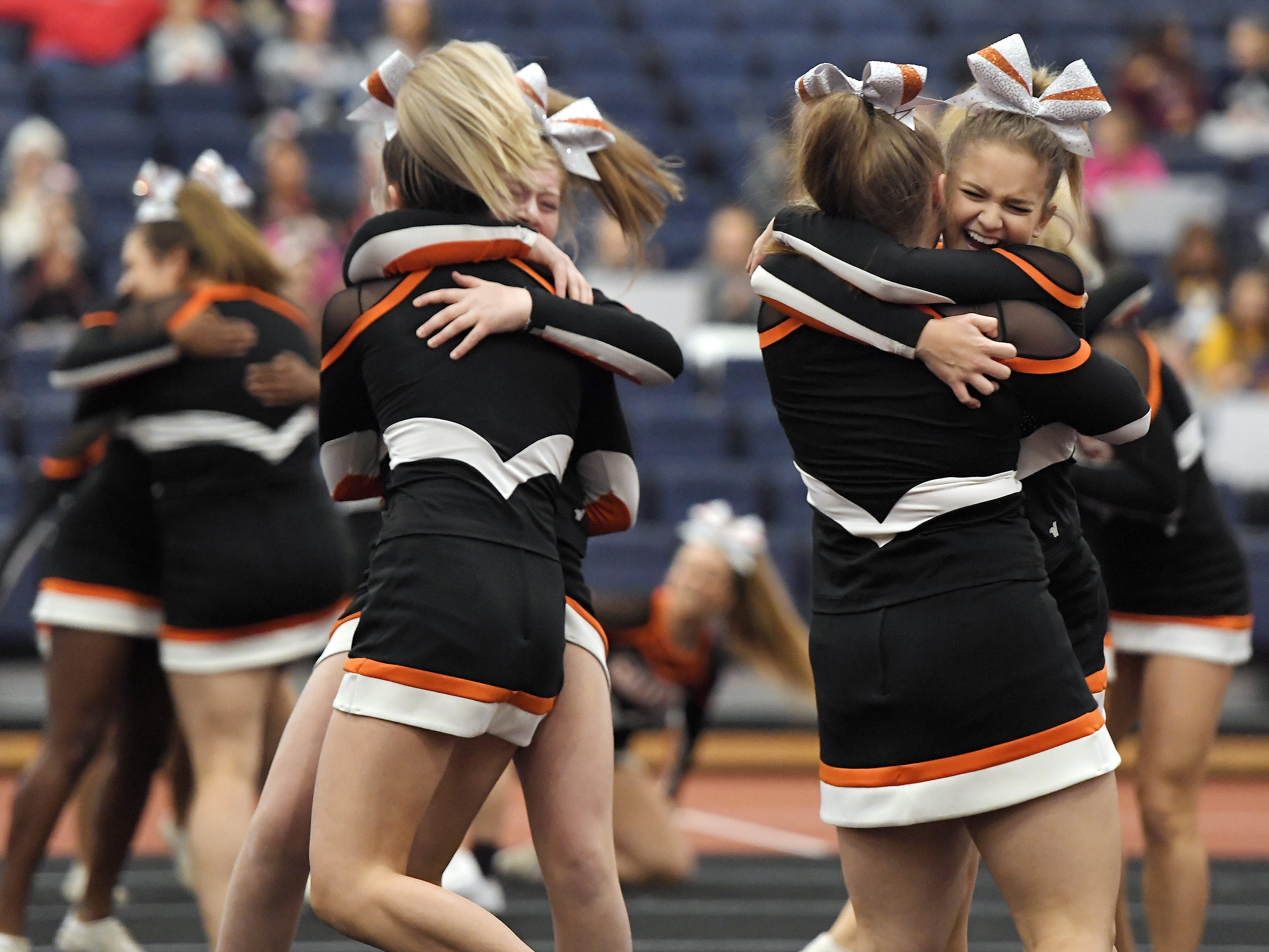 Churchville-Chili cheerleaders celebrate after their routine during the Section V Fall Cheerleading Championships at RIT, Saturday, Oct. 27, 2018.