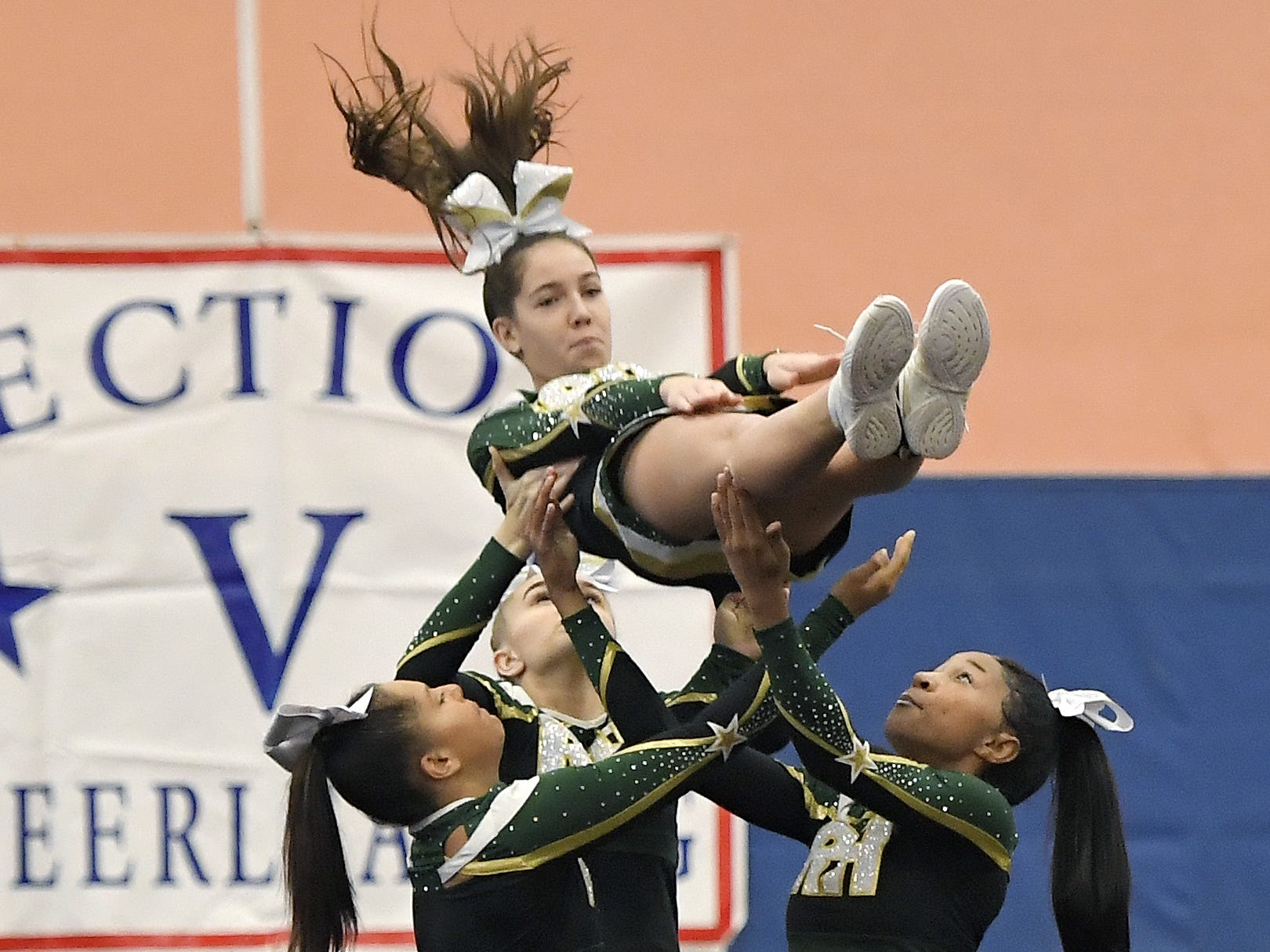Rush-Henrietta cheerleaders perform their routine during the Section V Fall Cheerleading Championships at RIT, Saturday, Oct. 27, 2018.