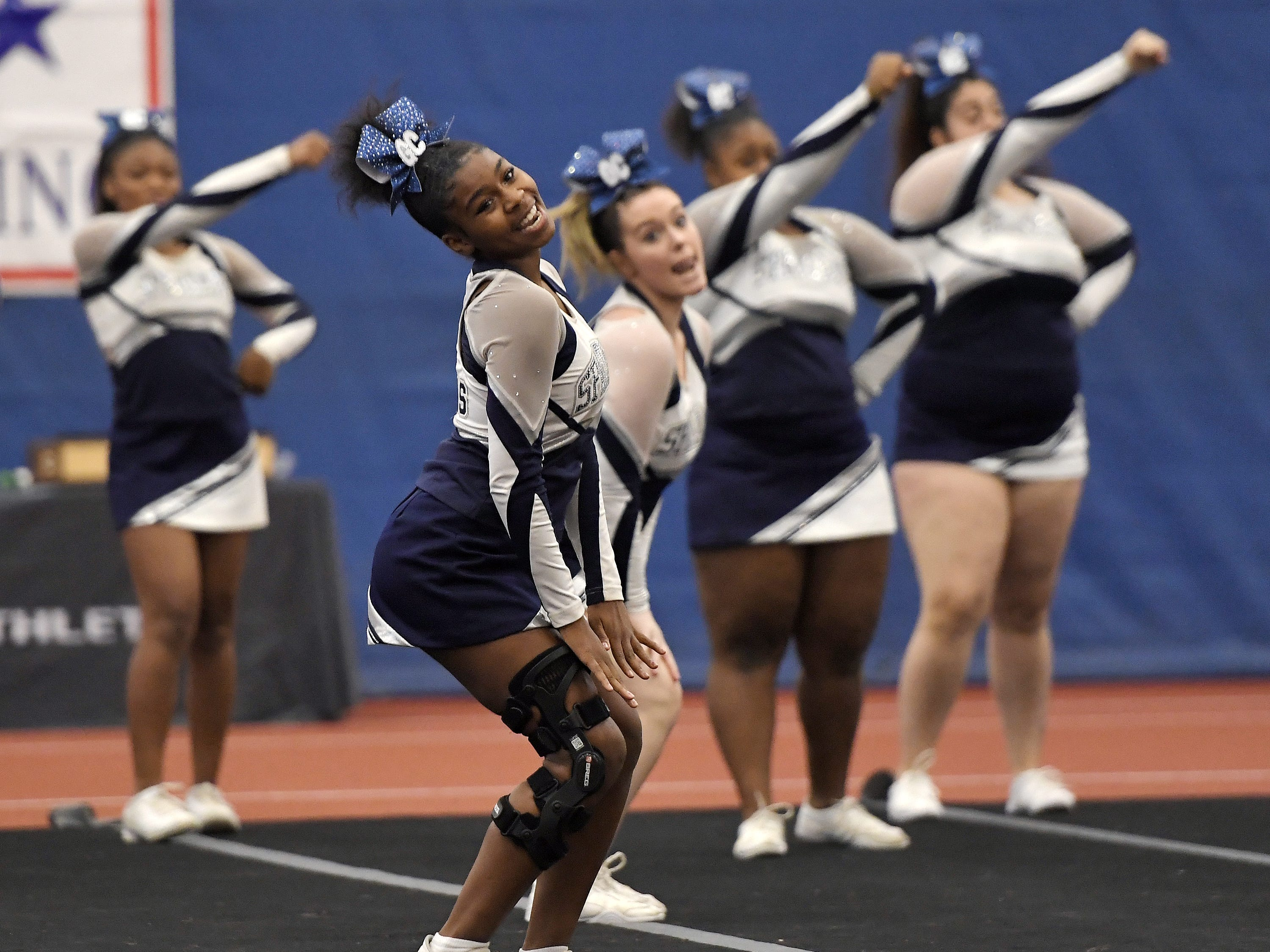 Gates Chili cheerleaders perform their routine during the Section V Fall Cheerleading Championships at RIT, Saturday, Oct. 27, 2018.