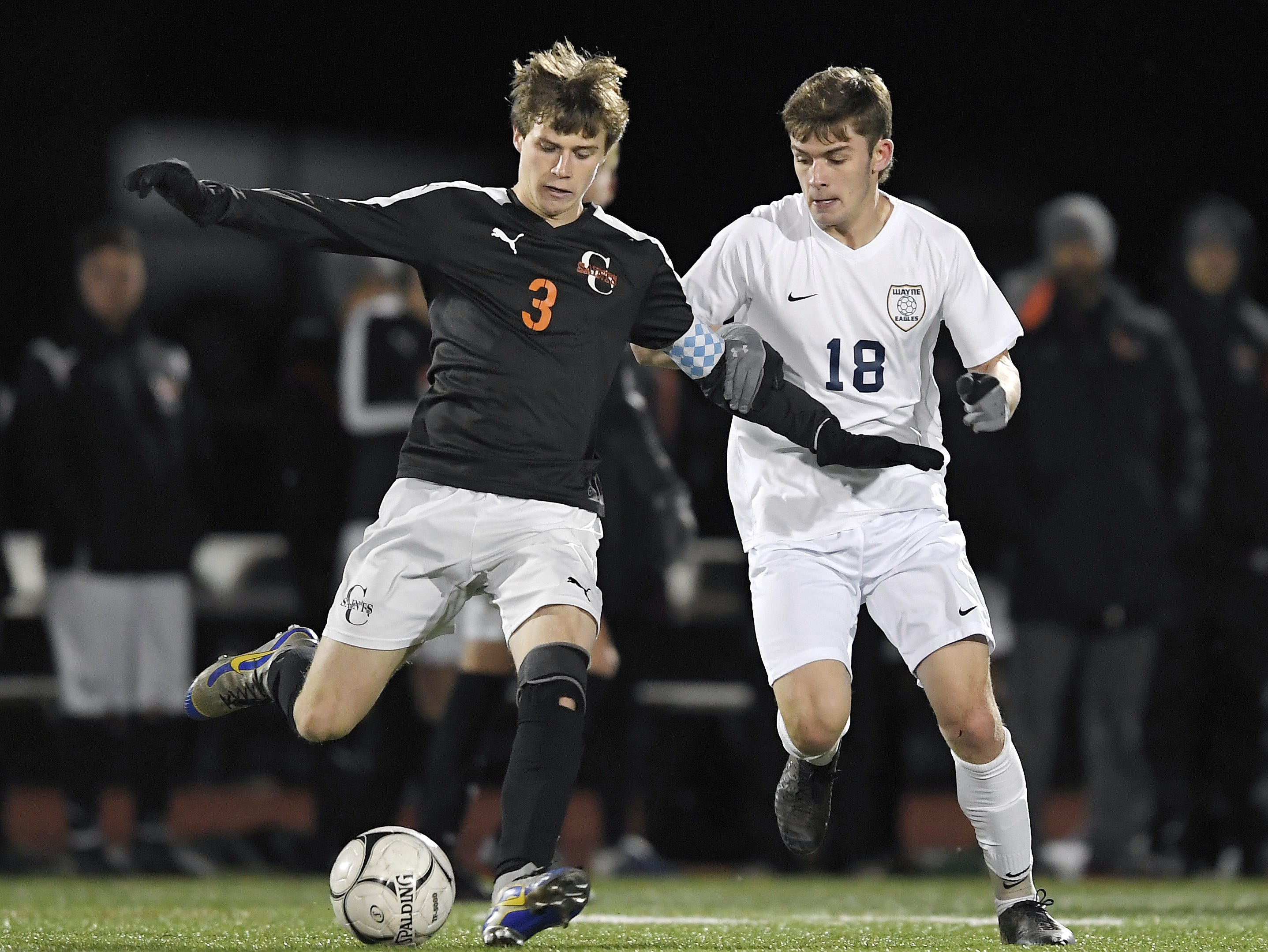 Churchville-Chili's Colby Egan, left, shields the ball from Wayne's Devin LaDue during a Class A sectional semifinal played at Hilton High School, Friday, Oct. 26, 2018.