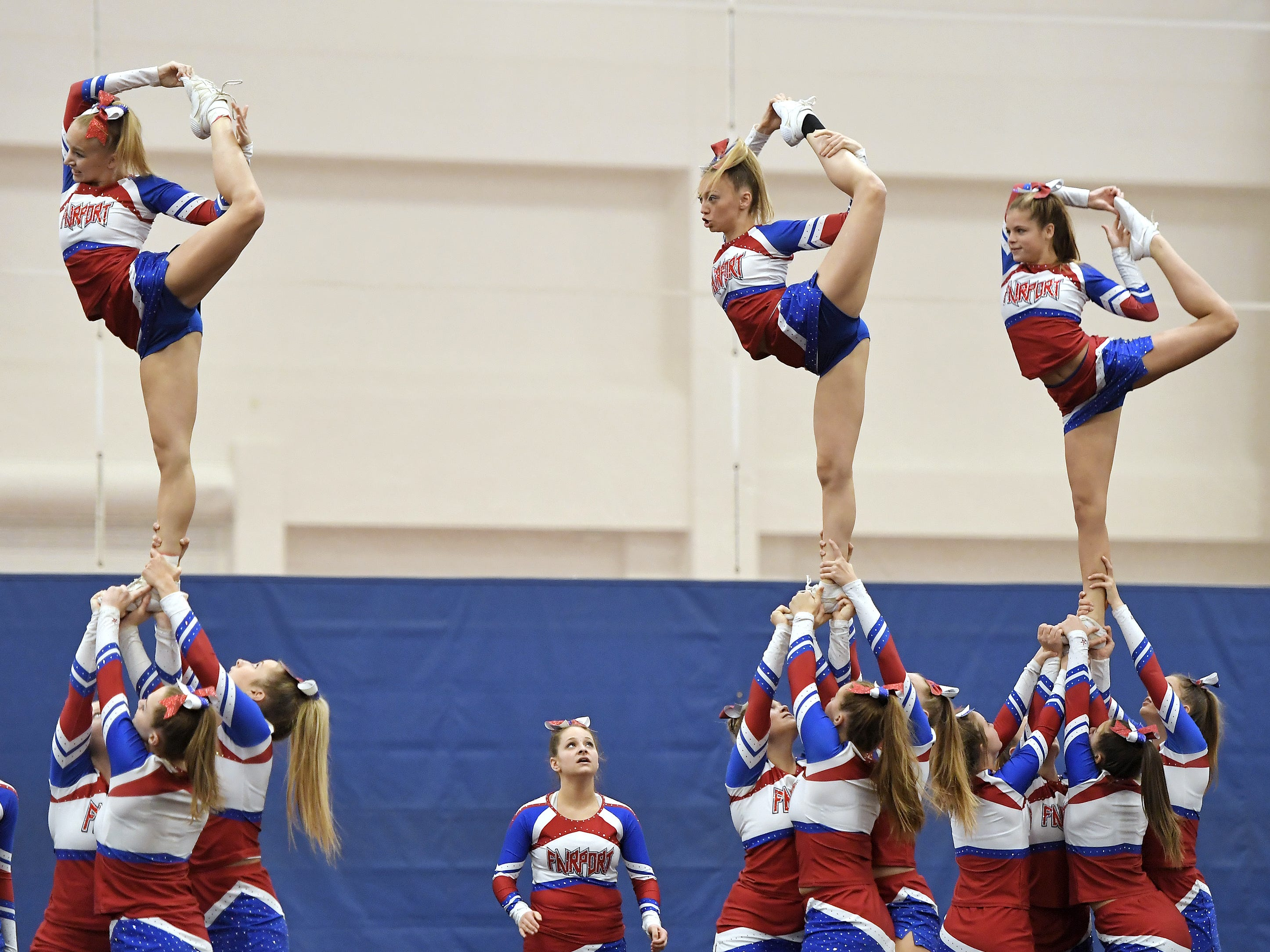 Fairport cheerleaders perform their routine during the Section V Fall Cheerleading Championships at RIT, Saturday, Oct. 27, 2018.