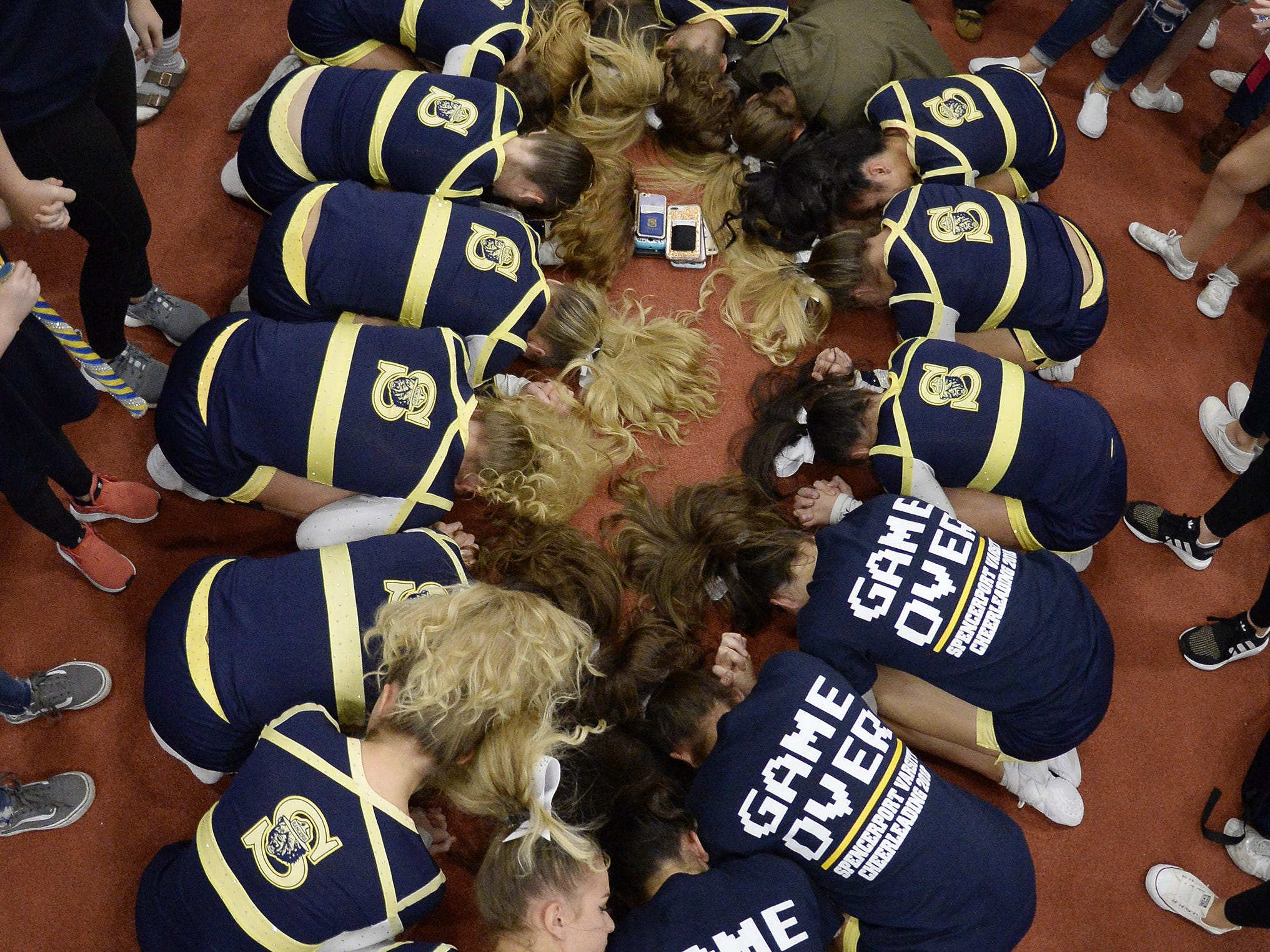 Spencerport cheerleaders wait for results during the Section V Fall Cheerleading Championships at RIT, Saturday, Oct. 27, 2018.