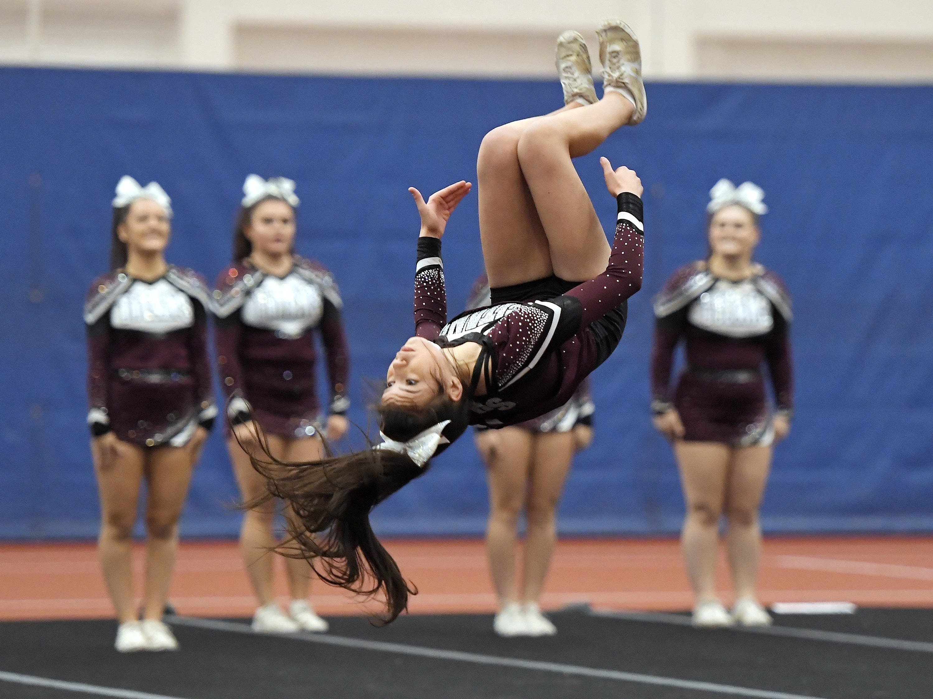 Greece Arcadia cheerleaders perform their routine during the Section V Fall Cheerleading Championships at RIT, Saturday, Oct. 27, 2018.