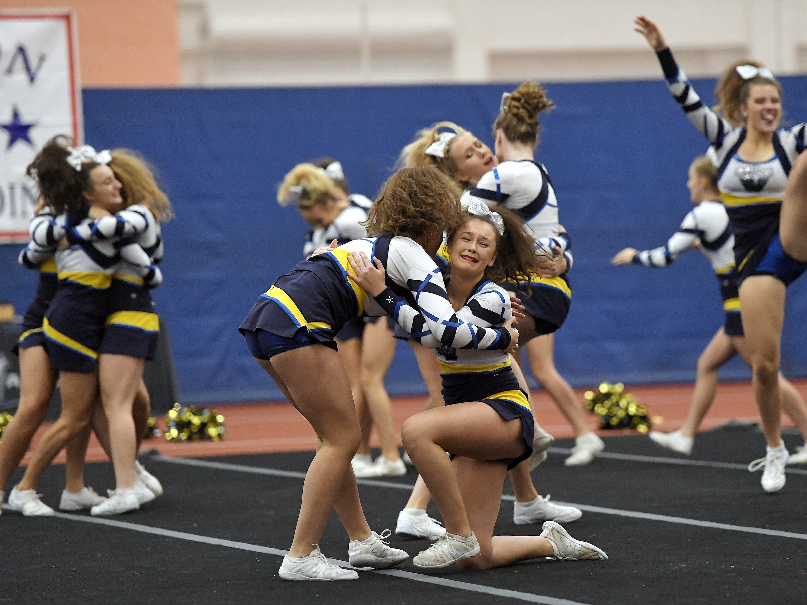 Victor cheerleaders celebrate after their routine during the Section V Fall Cheerleading Championships at RIT, Saturday, Oct. 27, 2018.