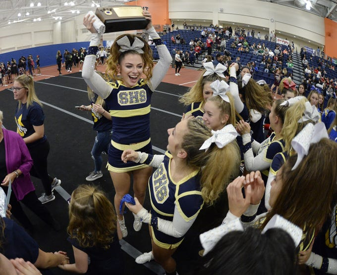 Spencerport captain Nicole Jackson celebrates with the championship block after her team won in Division 1-Small Schools during the Section V Fall Cheerleading Championships at RIT, Saturday, Oct. 27, 2018.