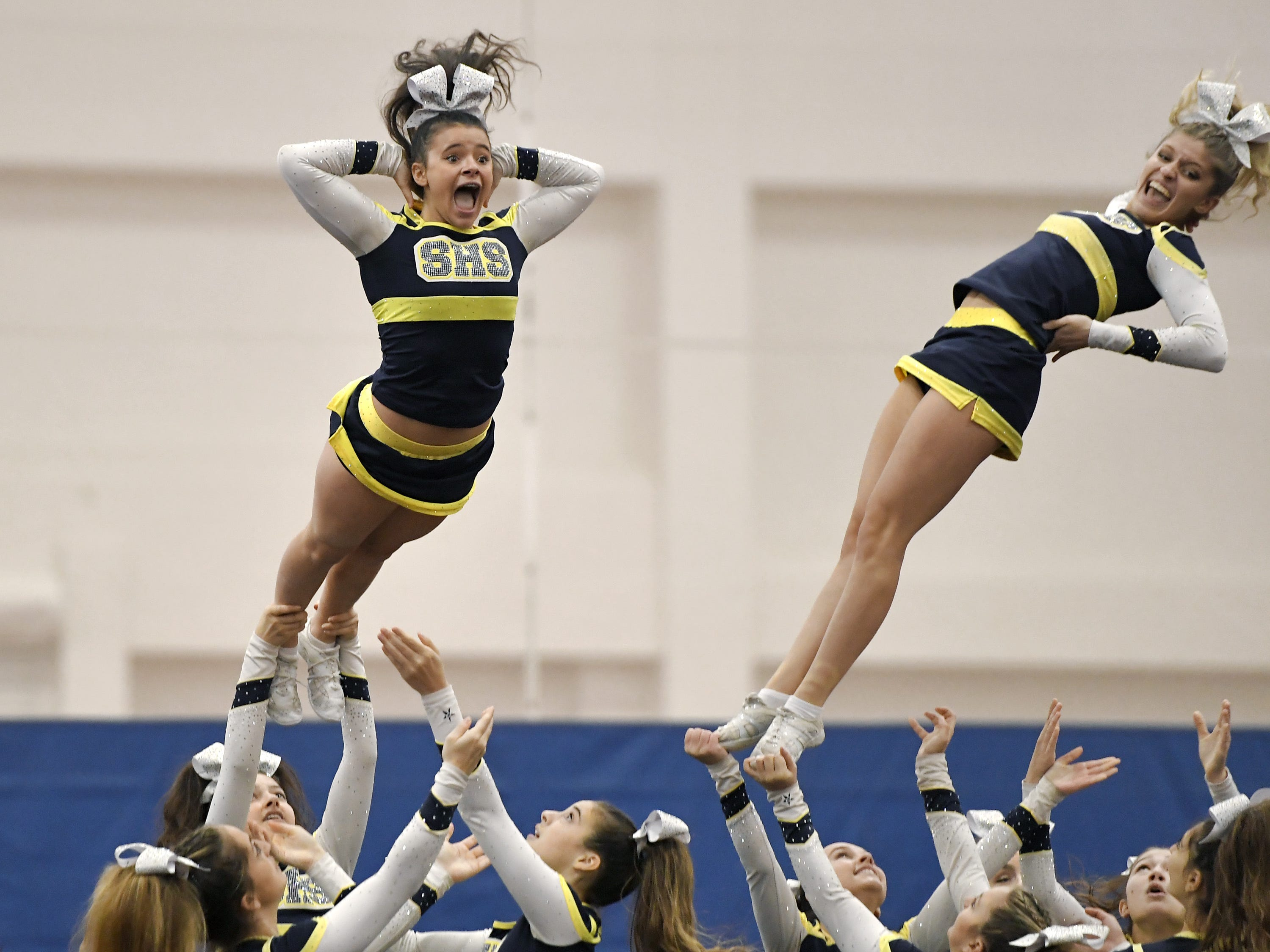 Spencerport cheerleaders perform their routine during the Section V Fall Cheerleading Championships at RIT, Saturday, Oct. 27, 2018.