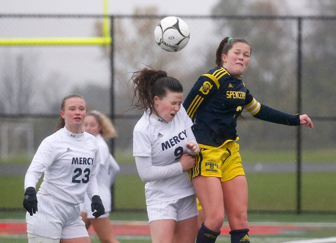 Mercy's Sissy Smith and Spencerport's Erin Coykendall, right, jump for the ball in the second half at Canandaigua Academy.