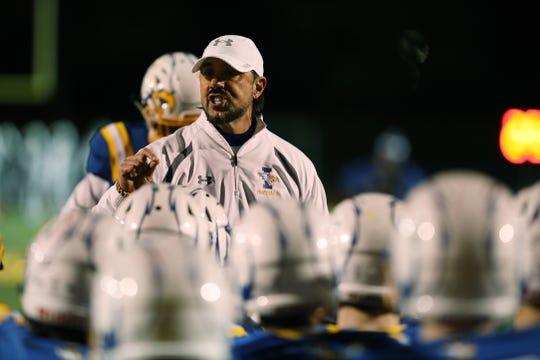 Irondequoit's head coach Dan Fichter talks to his team before they take the field.
