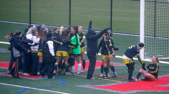 Spencerport celebrates a 3-2 win over Mercy in second overtime at Canandaigua Academy. The win gave the Rangers their third straight Section V title.
