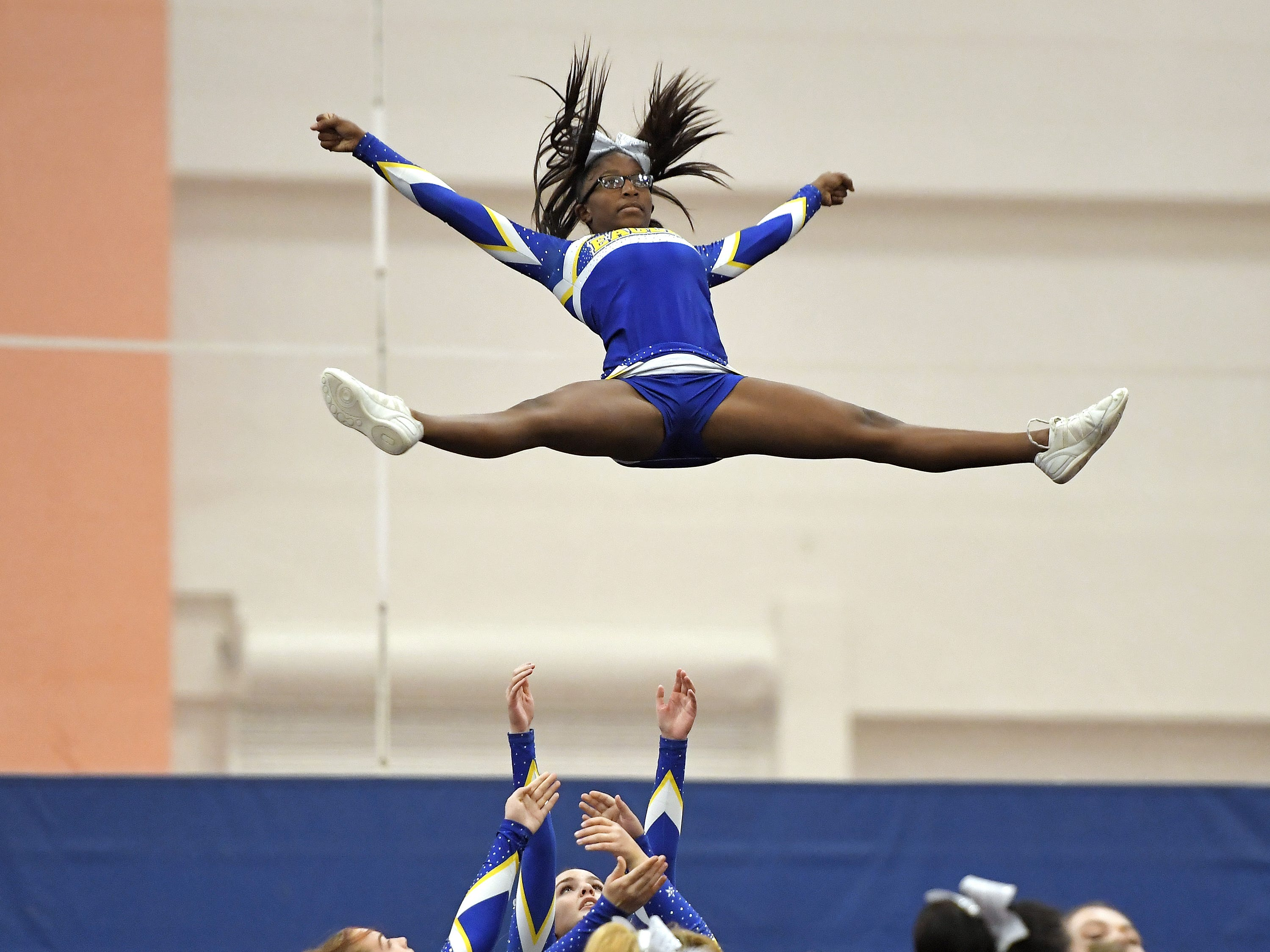 Irondequoit cheerleaders perform their routine during the Section V Fall Cheerleading Championships at RIT, Saturday, Oct. 27, 2018.