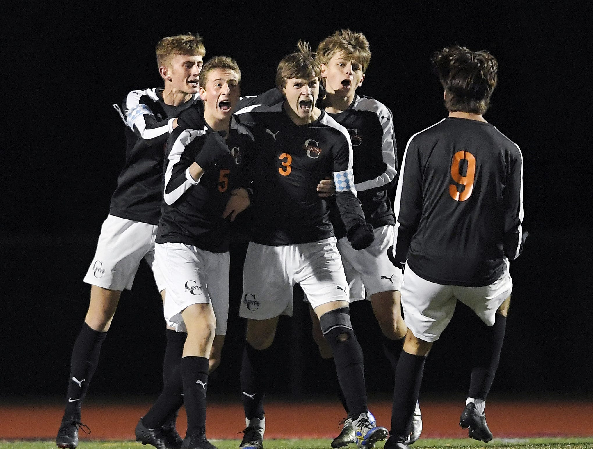 Churchville-Chili's Colby Egan (3) celebrates his goal with teammates during a Class A sectional semifinal against Wayne played at Hilton High School, Friday, Oct. 26, 2018. No. 1 seed Churchville-Chili advanced to the Class A final with a 3-2 win over No. 4 seed Wayne.