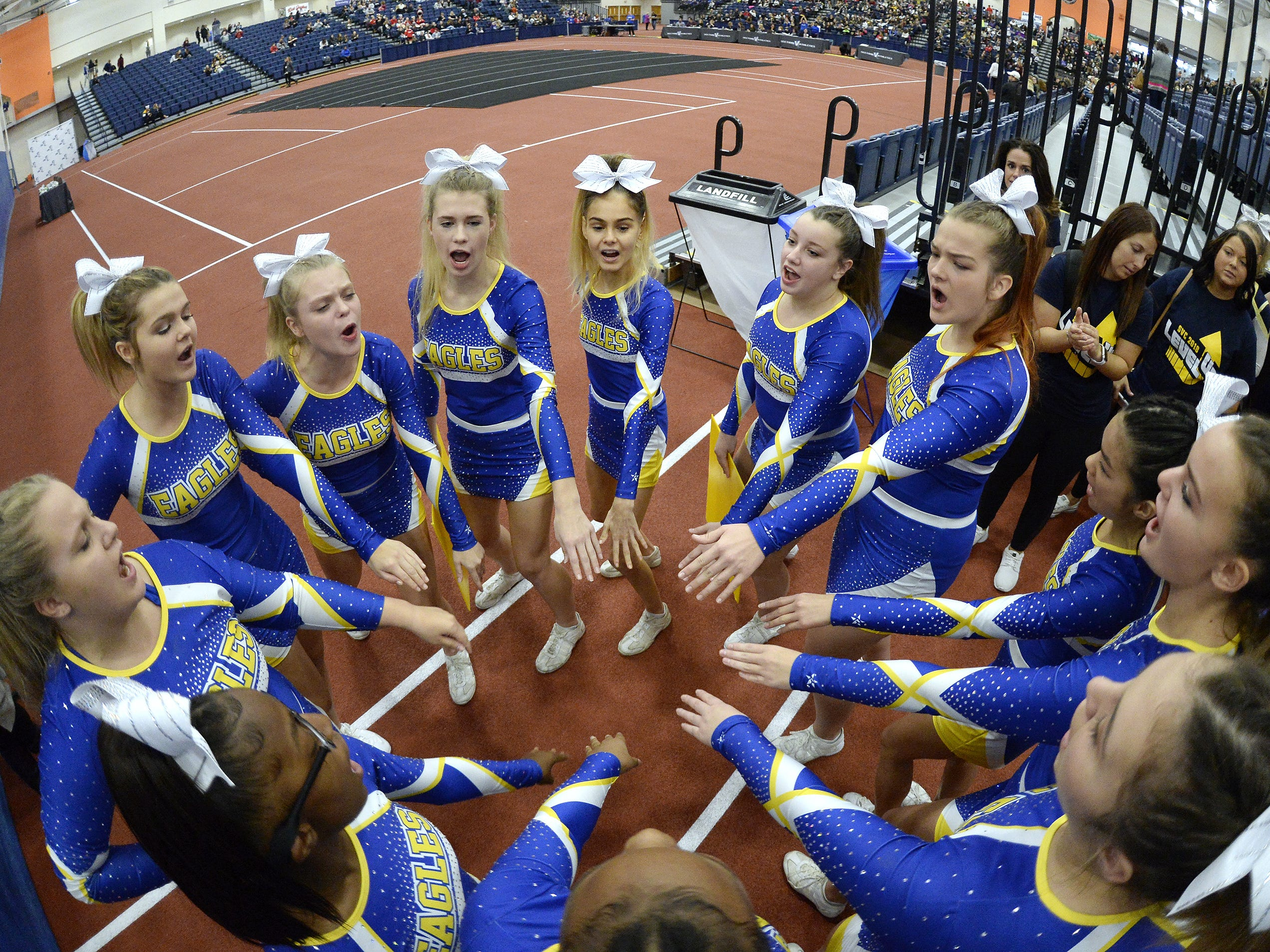 Irondequoit cheerleaders prepare to perform their routine during the Section V Fall Cheerleading Championships at RIT, Saturday, Oct. 27, 2018.