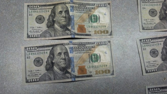 Recovered counterfeit money in Gates.