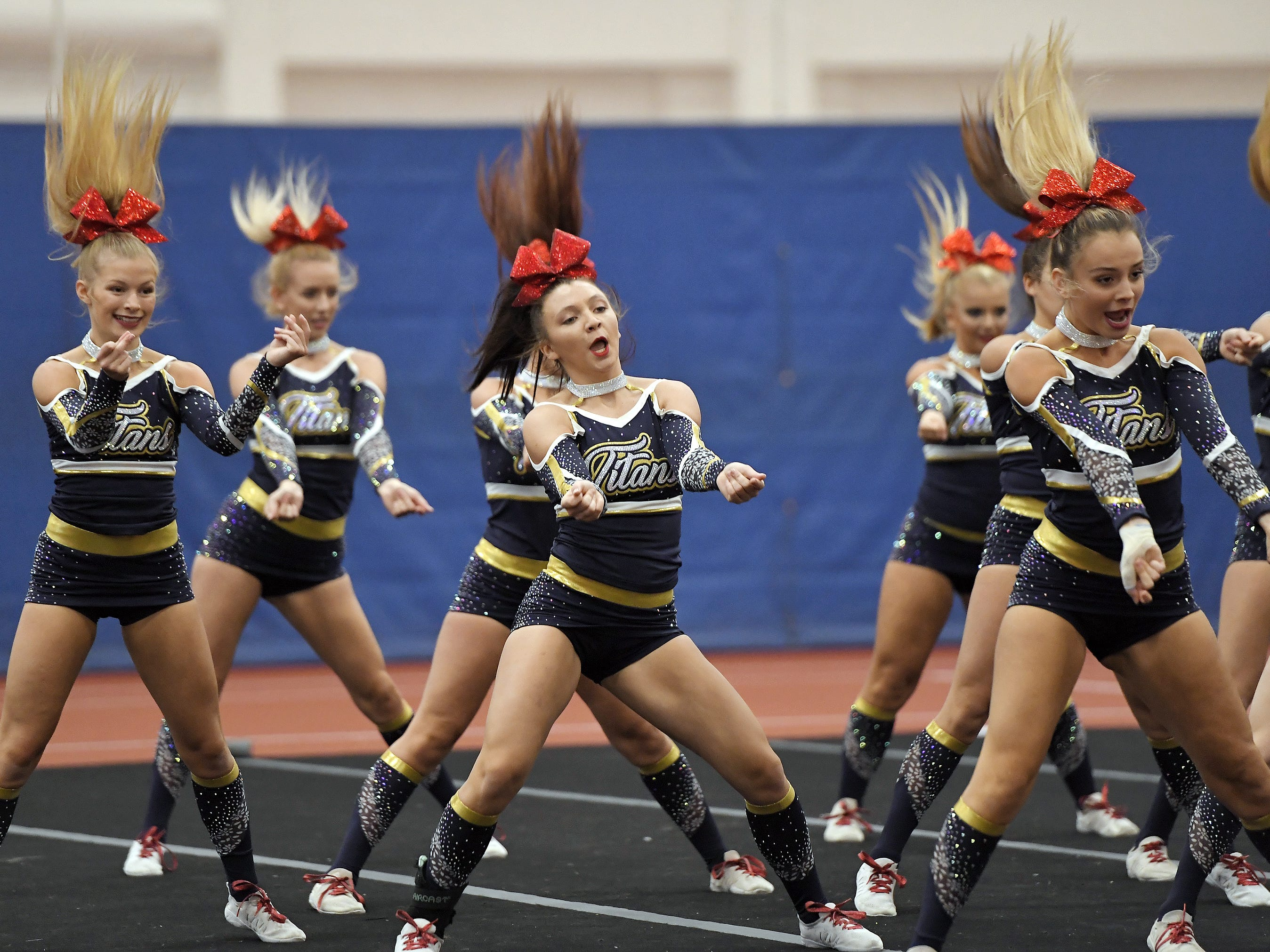 Webster Thomas cheerleaders perform their routine during the Section V Fall Cheerleading Championships at RIT, Saturday, Oct. 27, 2018.