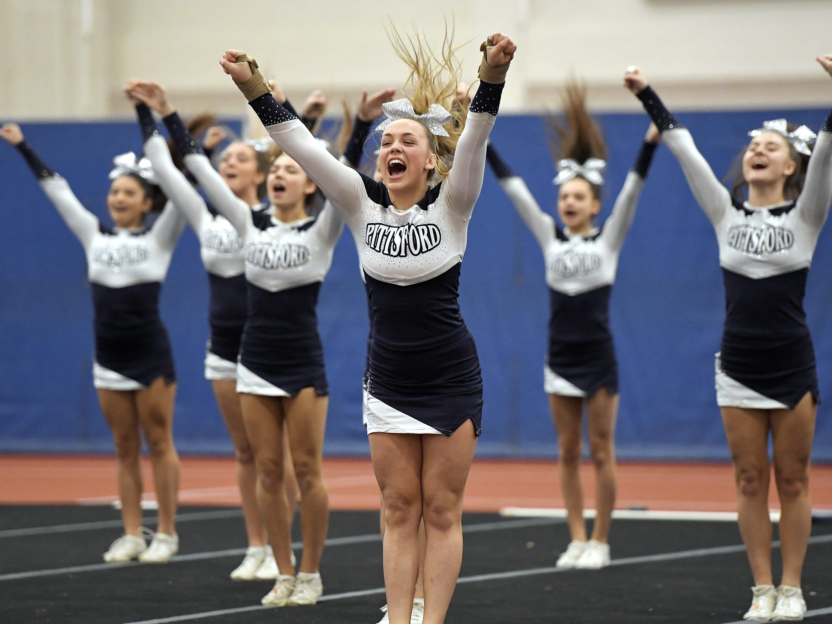 Pittsford cheerleaders perform their routine during the Section V Fall Cheerleading Championships at RIT, Saturday, Oct. 27, 2018.