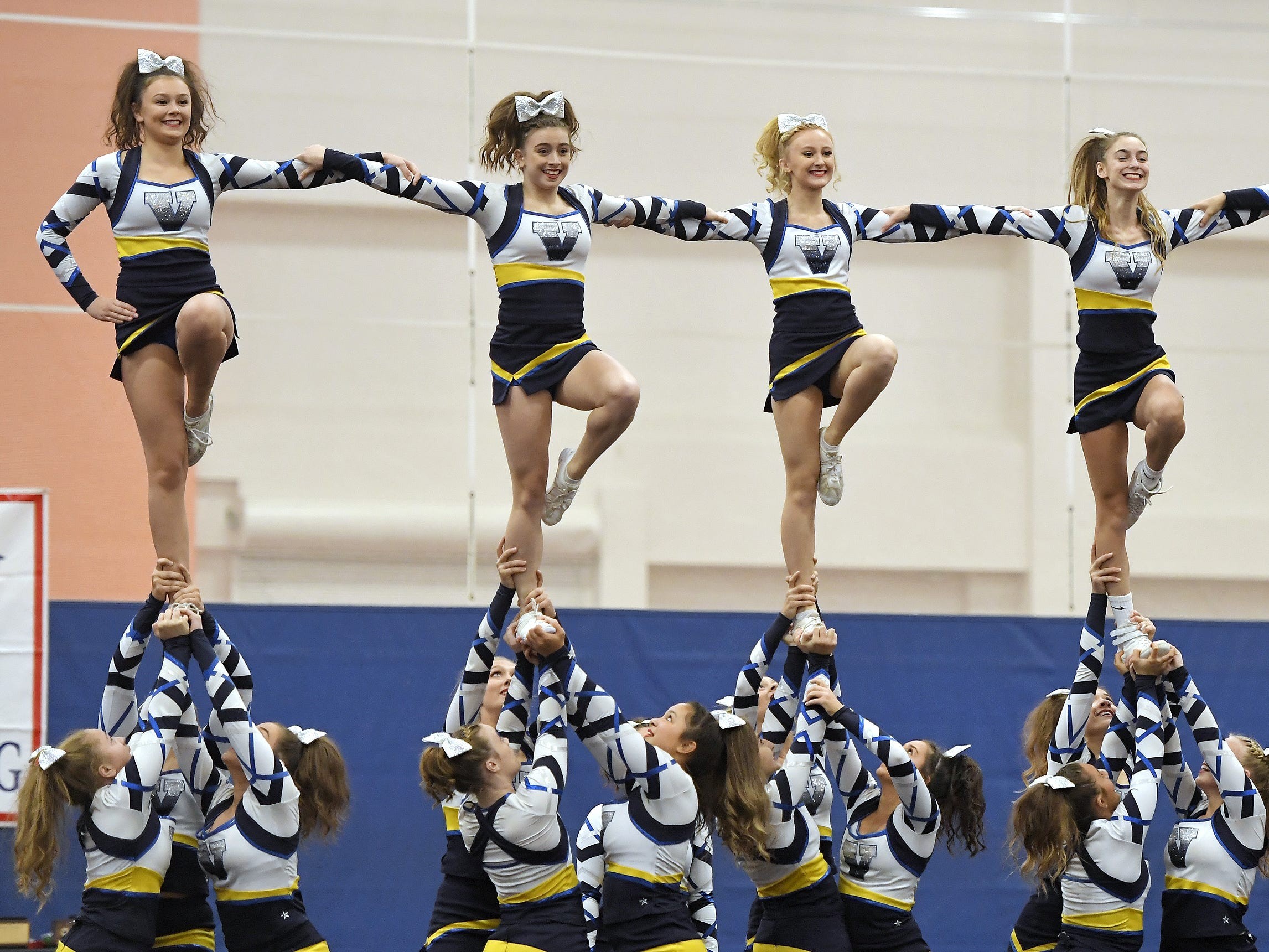 Victor cheerleaders perform their routine during the Section V Fall Cheerleading Championships at RIT, Saturday, Oct. 27, 2018.