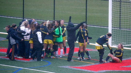 Spencerport celebrates its 3-2 overtime win against Mercy in the Section V Class A championship match Saturday at Canandaigua. The Rangers have won three straight titles.