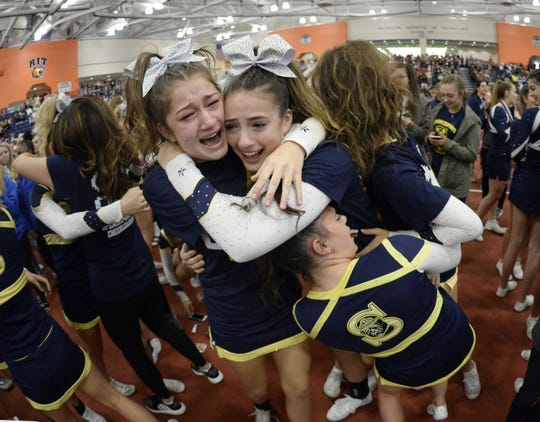 Spencerport cheerleaders celebrate winning Division 1-Small Schools during the Section V Fall Cheerleading Championships at RIT, Saturday, Oct. 27, 2018.