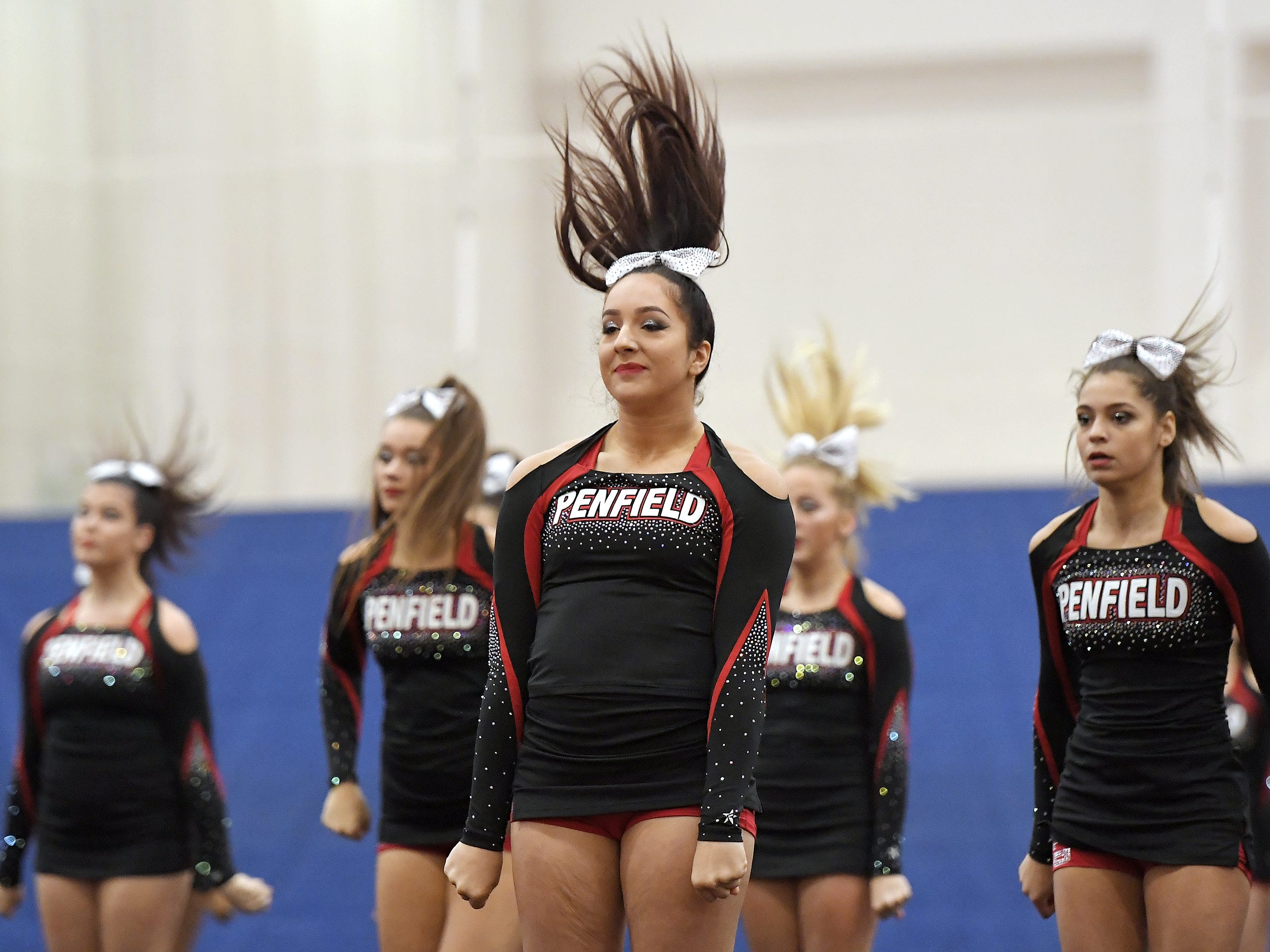 Penfield cheerleaders perform their routine during the Section V Fall Cheerleading Championships at RIT, Saturday, Oct. 27, 2018.