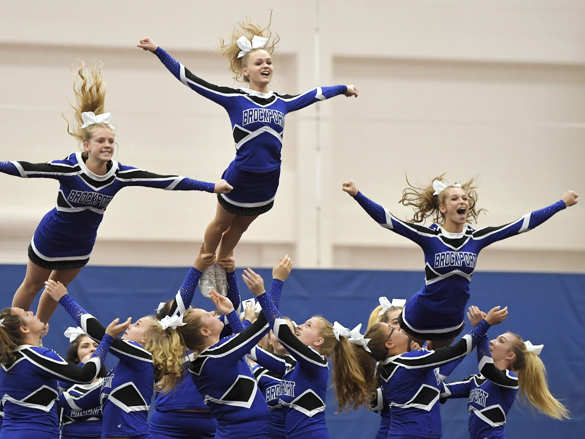 Brockport cheerleaders perform their routine during the Section V Fall Cheerleading Championships at RIT, Saturday, Oct. 27, 2018.