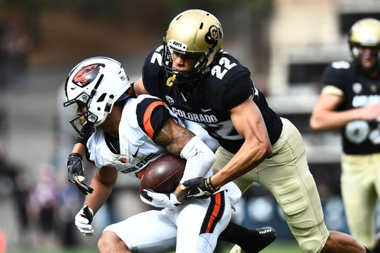 Oct 27, 2018; Boulder, CO, USA; Colorado Buffaloes wide receiver Daniel Arias (22) tackles Oregon State Beavers wide receiver Trevon Bradford (8) in the first quarter at Folsom Field. Mandatory Credit: Ron Chenoy-USA TODAY Sports